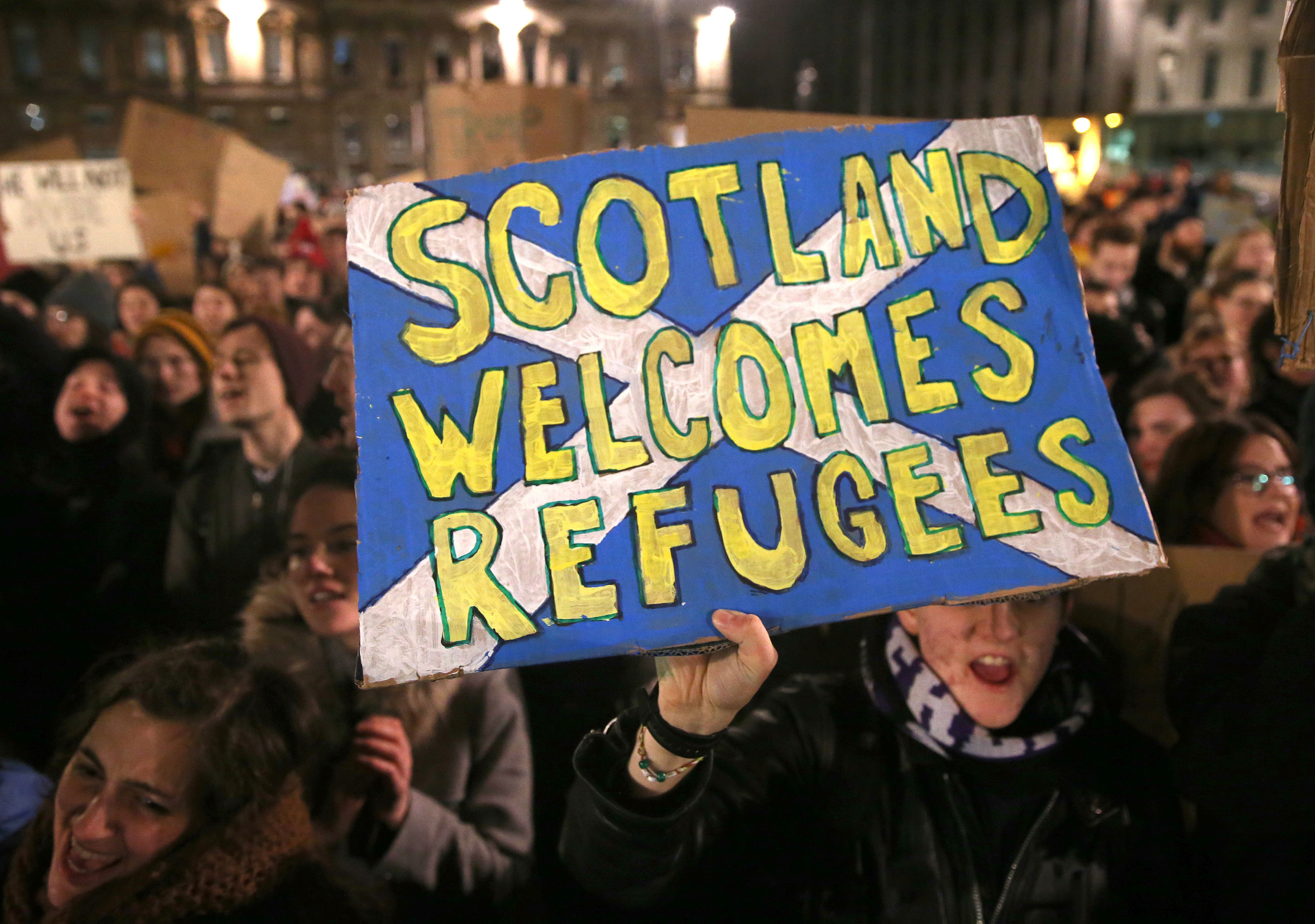 Demonstrators during a protest in Glasgow against US President Donald Trump's controversial travel ban on refugees and people from seven mainly-Muslim countries.