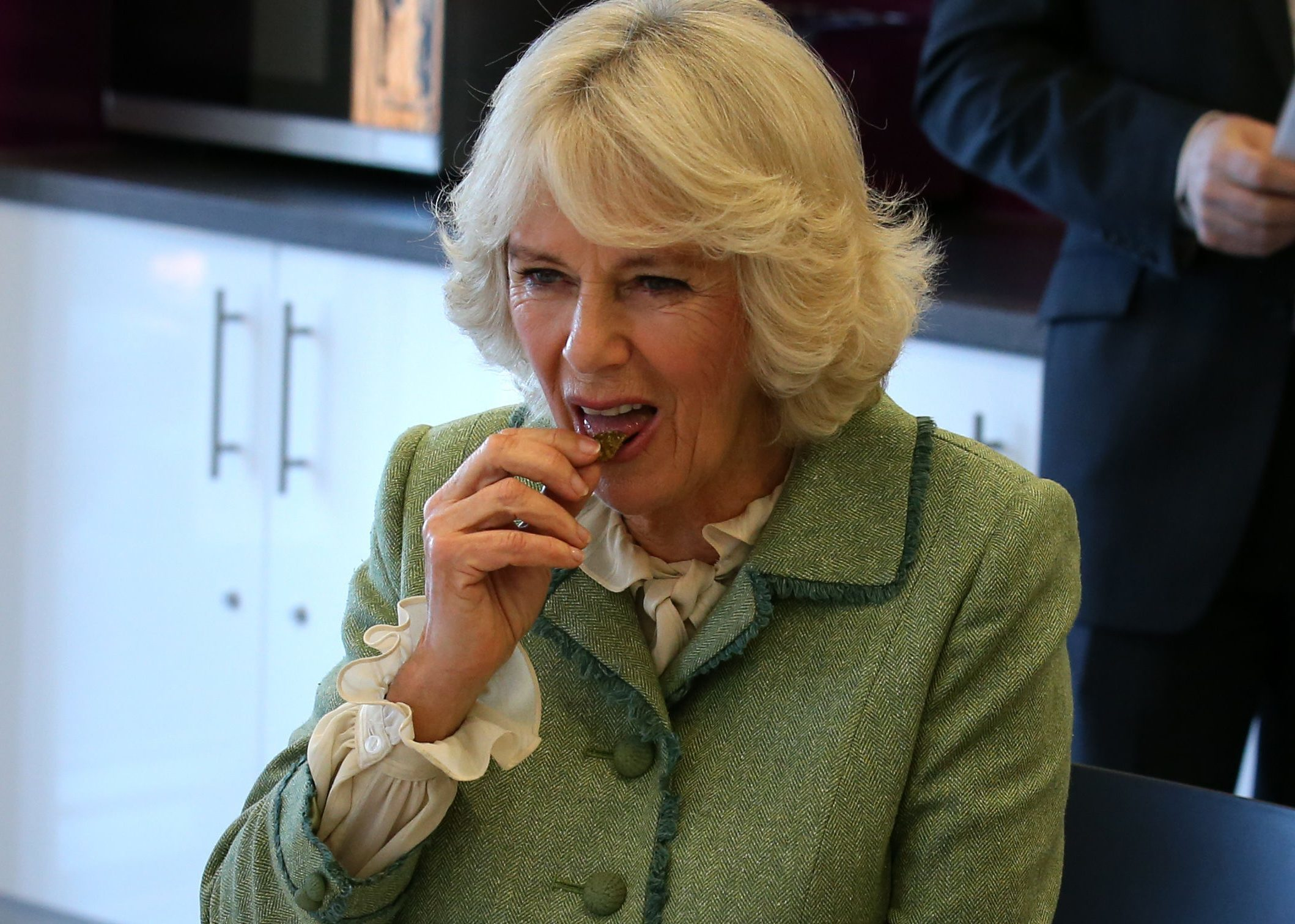 The Duchess of Cornwall, known as the Duchess of Rothesay while in Scotland, eats broccoli crisp bread in the Nutrition Kitchen during a visit to the new Rowett Institute of Nutrition and Healthy (Andrew Milligan/PA Wire)
