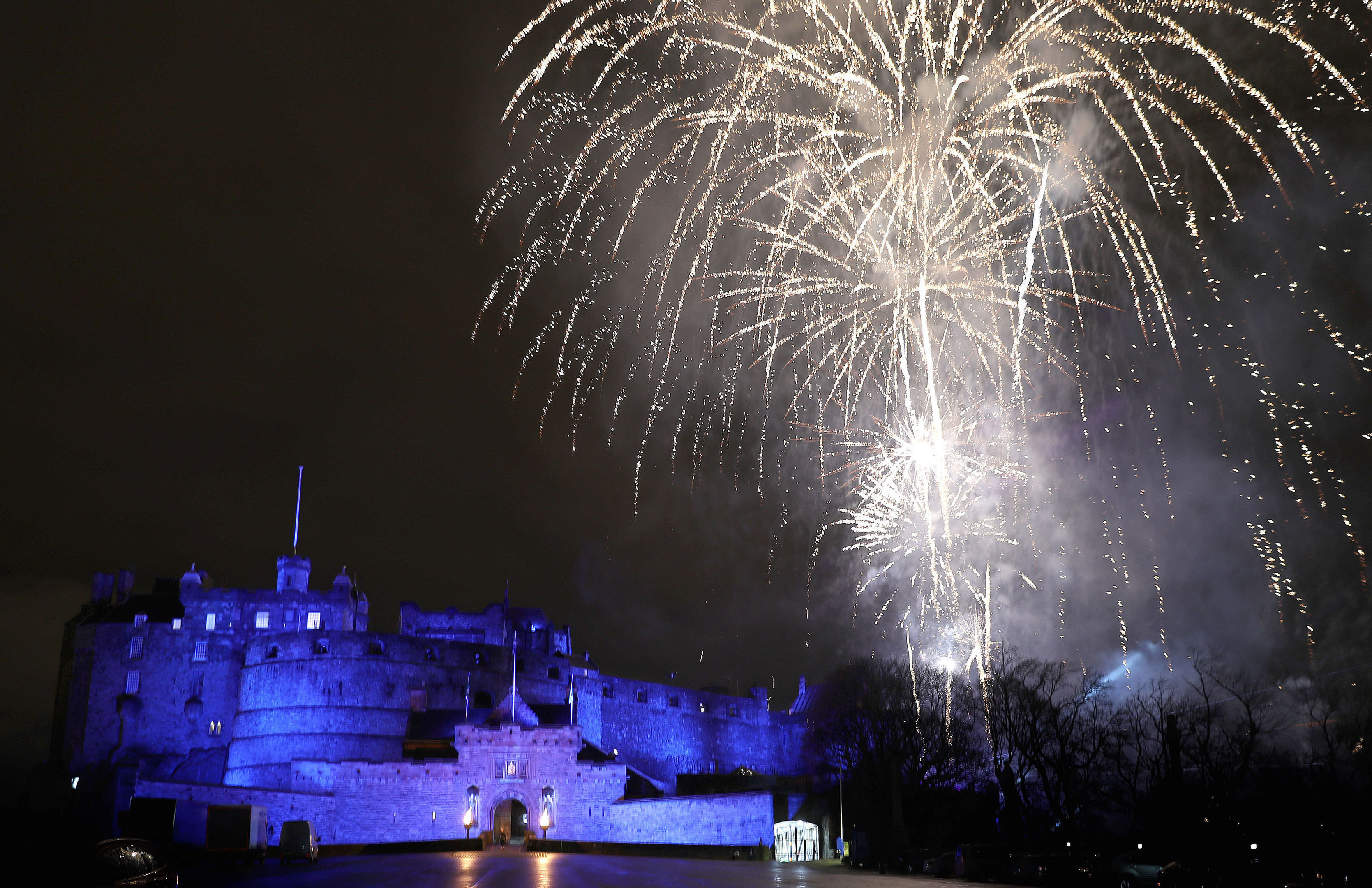 Fireworks light up the sky during the Hogmanay New Year celebrations in Edinburgh (Andrew Milligan/PA Wire)