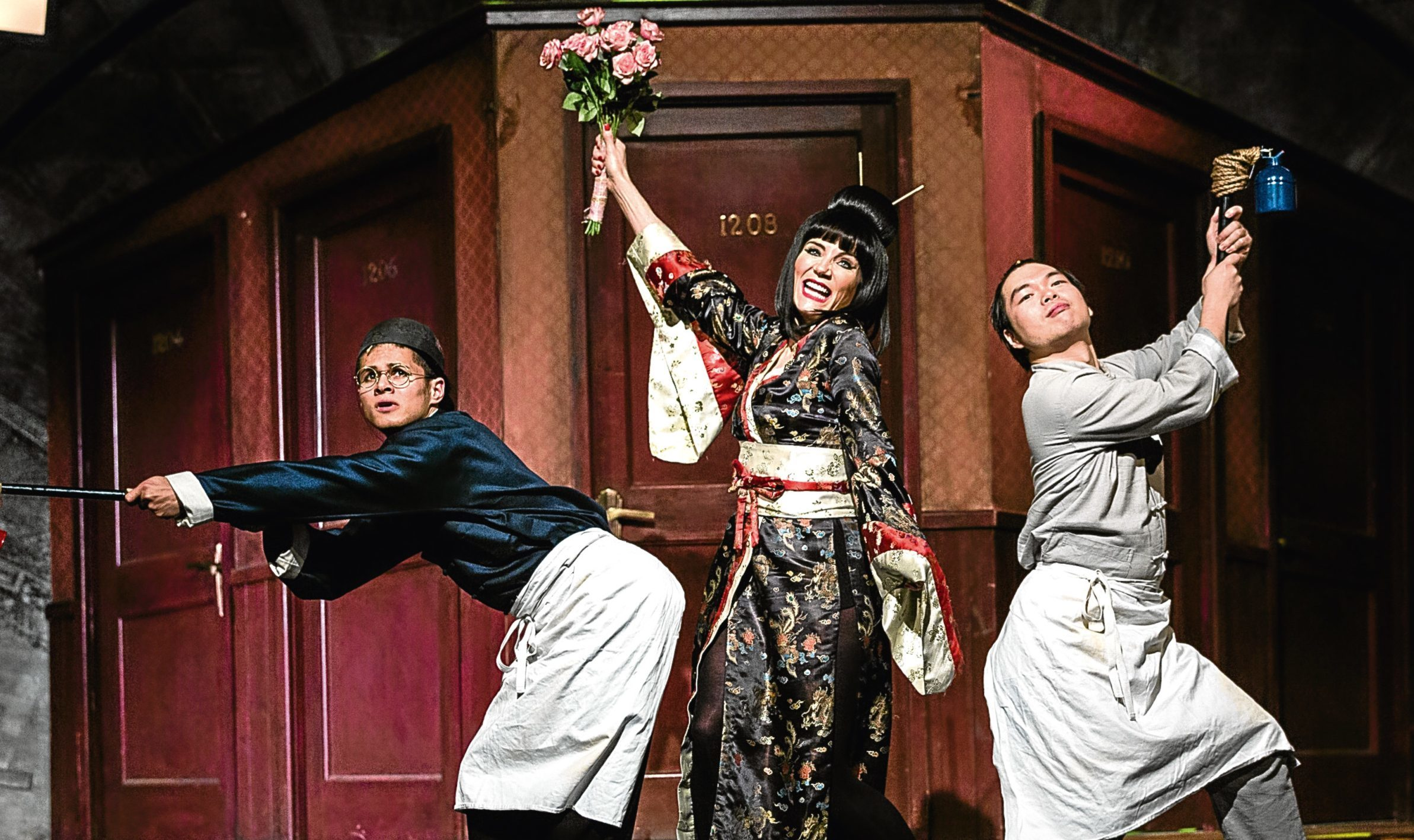 Damian Buhagiar as Ching Ho, Michelle Collins as Mrs Meers and Andy Yau as Bun Foo in Thoroughly Modern Millie (Darren Bell)
