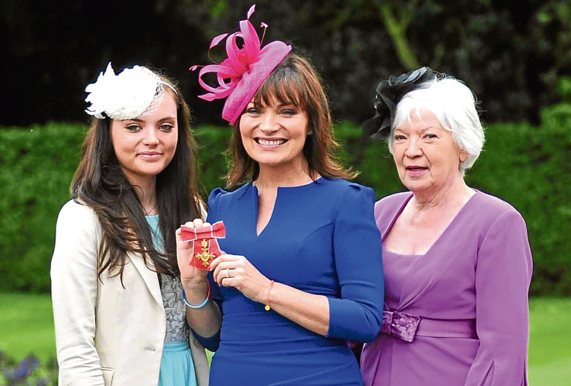Lorraine Kelly gets her MBE with L-R daughter Rosie, Lorraine, and mum Anne