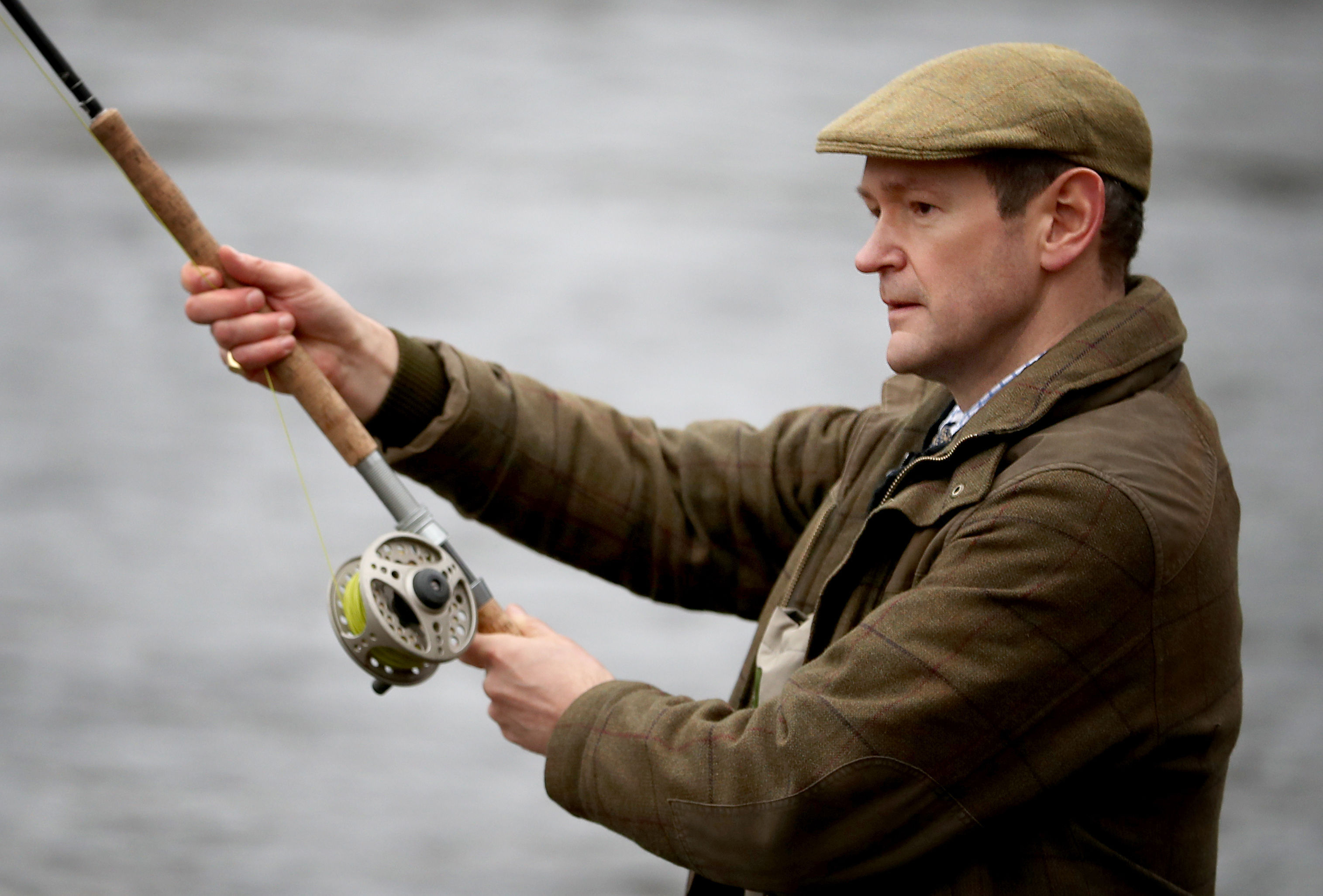 Comedian and presenter Alexander Armstrong makes the first cast to officially open the new fishing season on the River Dee at Banchory.  (Jane Barlow/PA Wire)