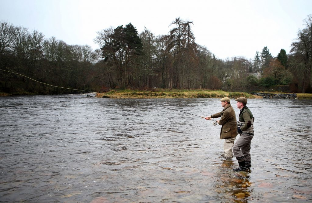Alexander Armstrong (left), with ghillie Jordan Sinclair (Jane Barlow/PA Wire)