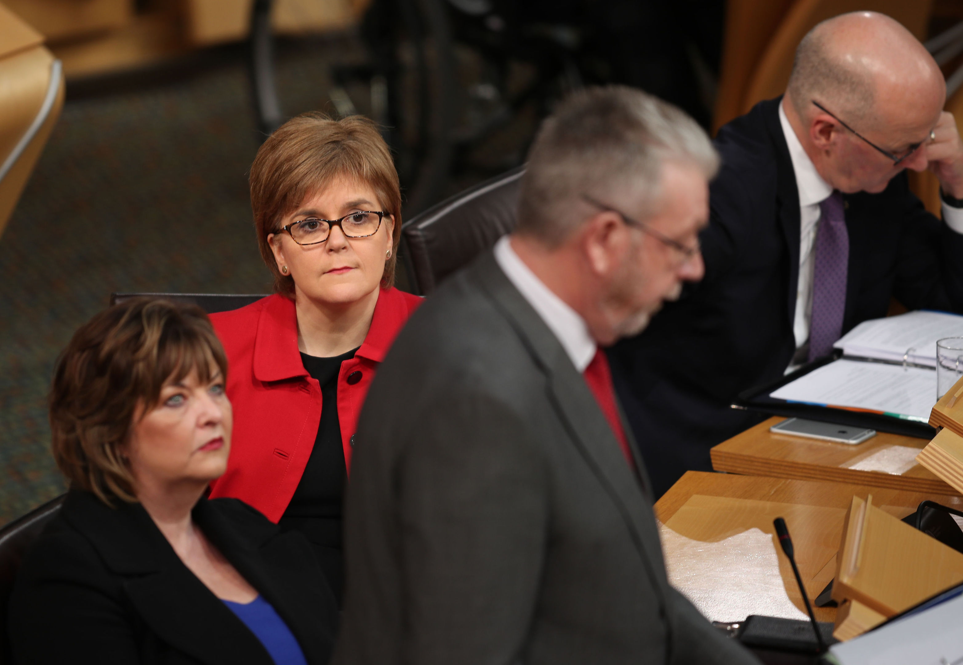 First Minister Nicola Sturgeon listens as the Minister for UK Negotiations on Scotland's Place in Europe Mike Russell speaks during the Scottish Parliament debate on the triggering of Article 50 in the main chamber of the Scottish Parliament. (Jane Barlow/PA Wire)
