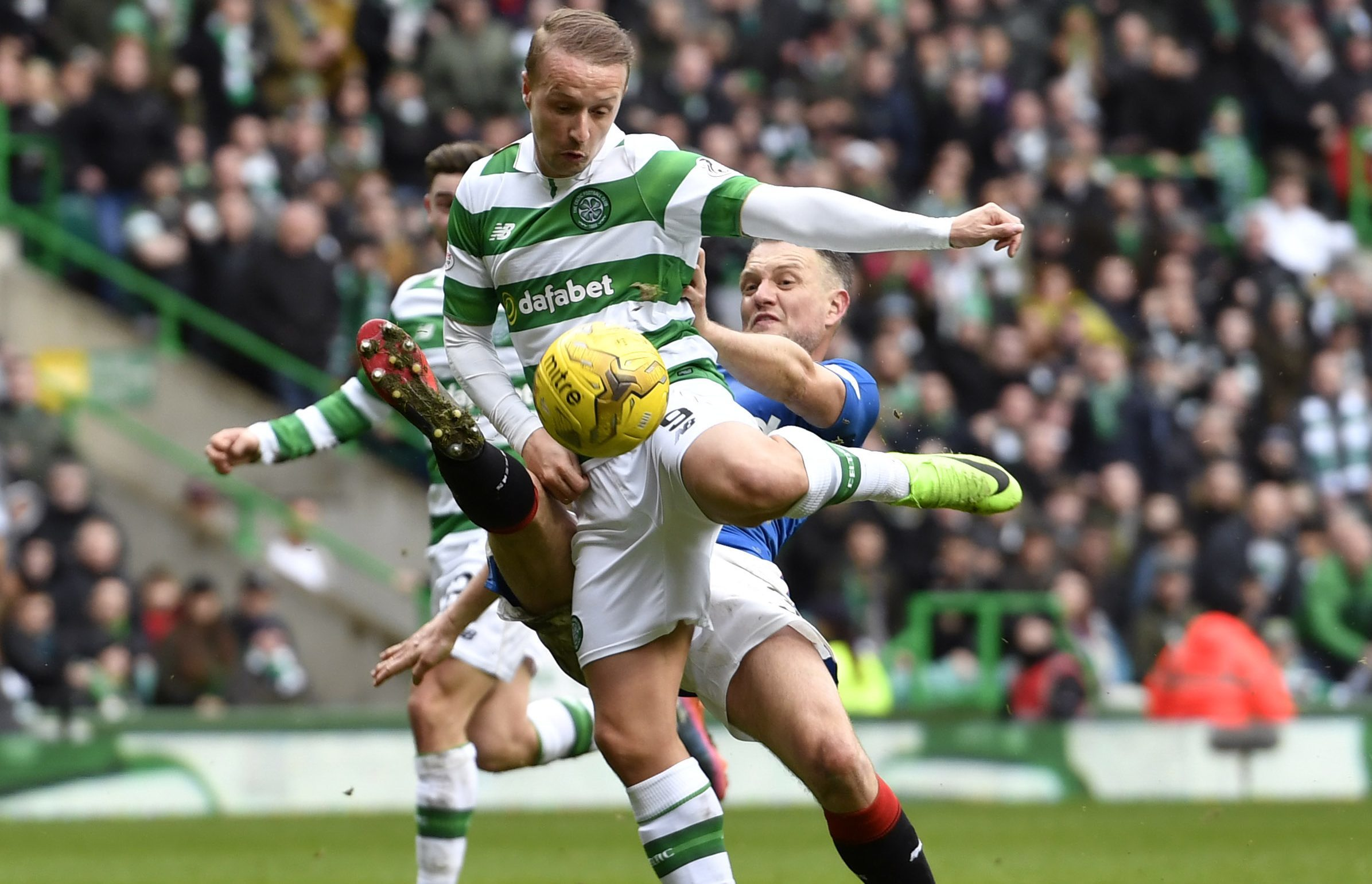 Celtic's players appeal for a penalty as Leigh Griffiths (left) is tackled by Rangers' Clint Hill in the last minute (SNS)