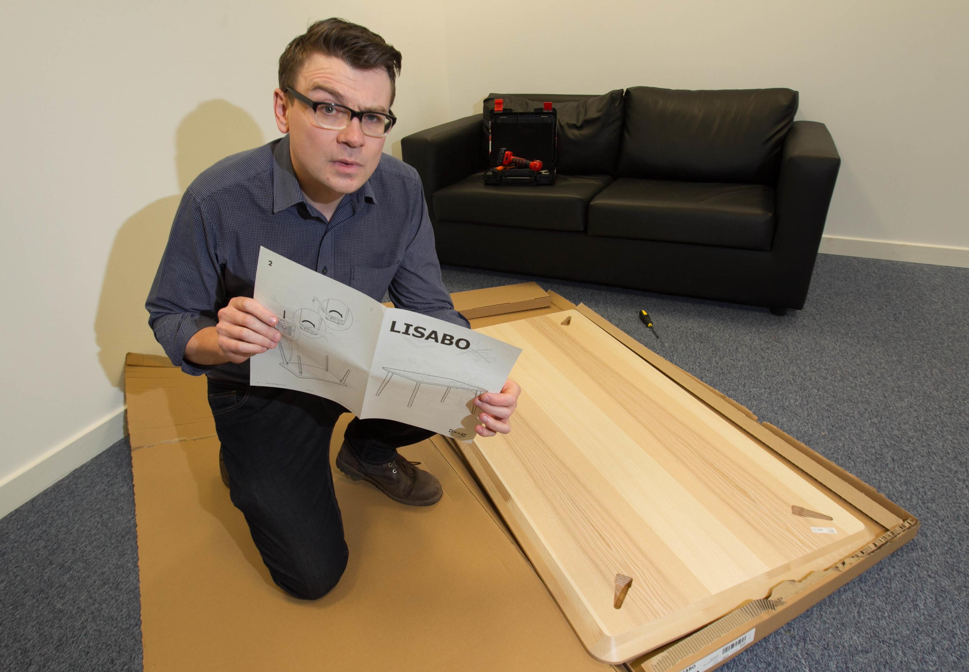 Reporter Stevie Gallacher builds an ikea table in under 10mins. (Chris Austin)