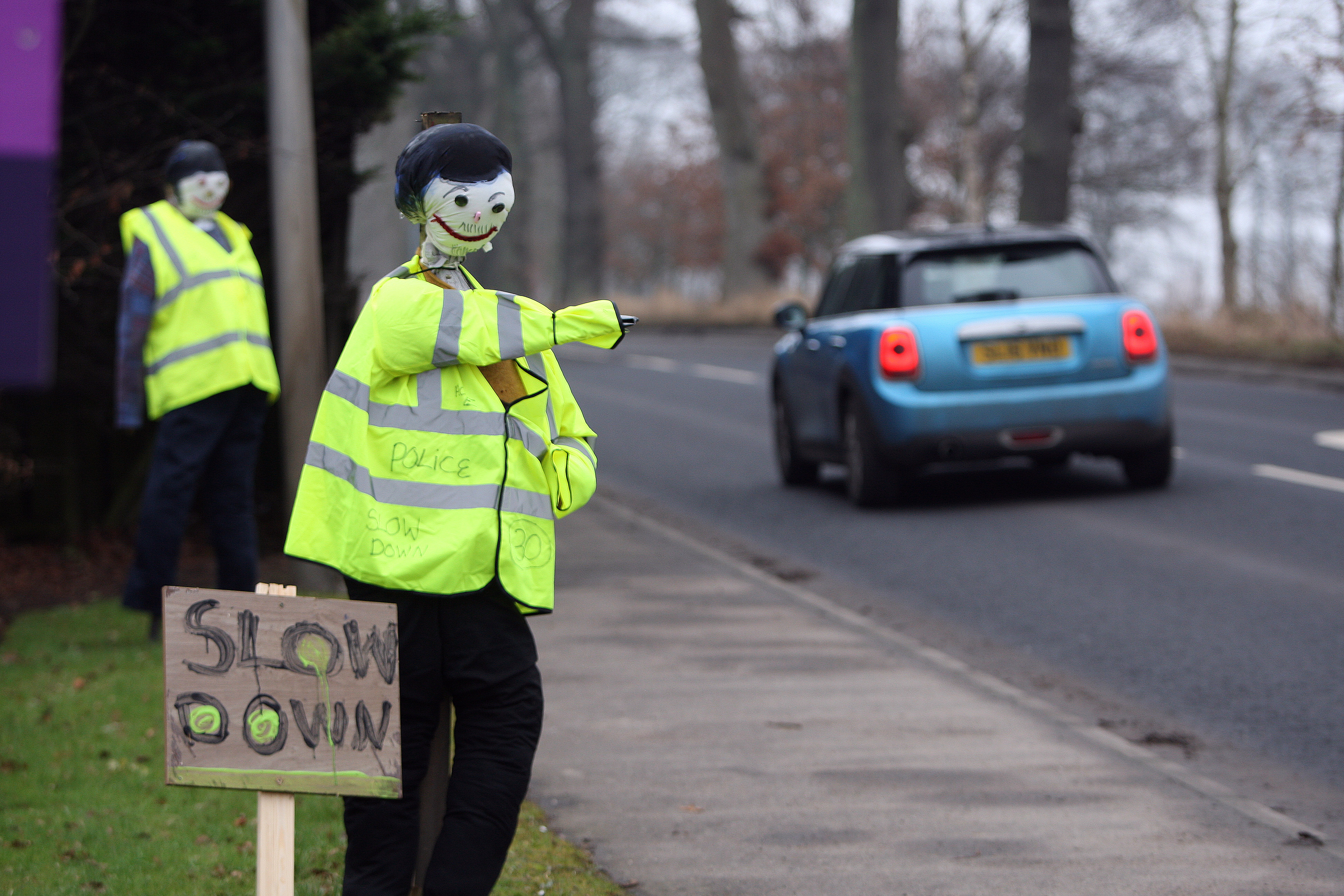 Scarecrow policemen have made an appearance on land near to where Harlow Edwards was tragically killed by a car mounting the pavement (DC Thomson)
