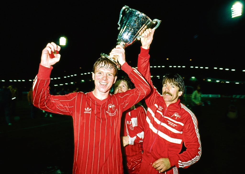 Alex McLeish, left and Stuart Kennedy celebrate with the trophy.