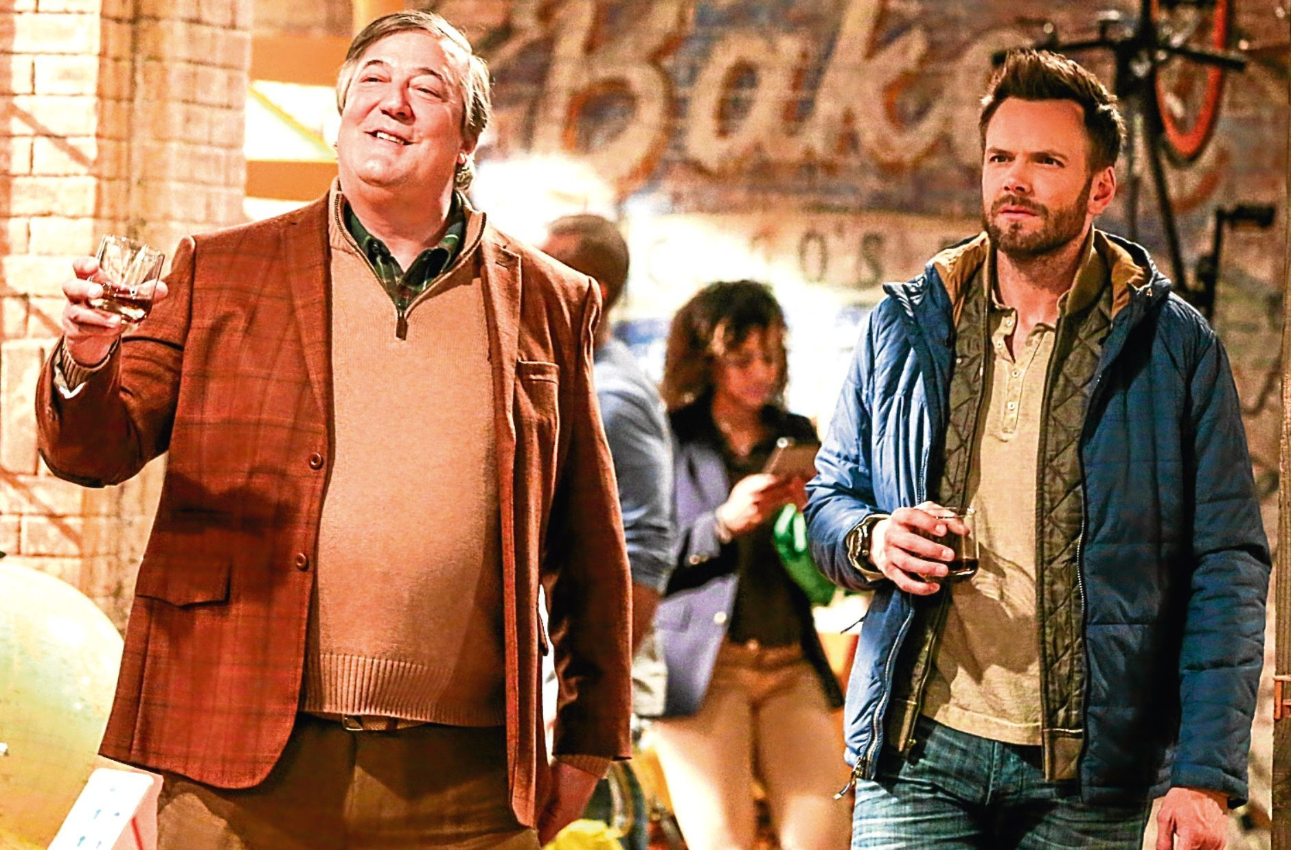 Stephen Fry alongside Joel McHale in The Great Indoors