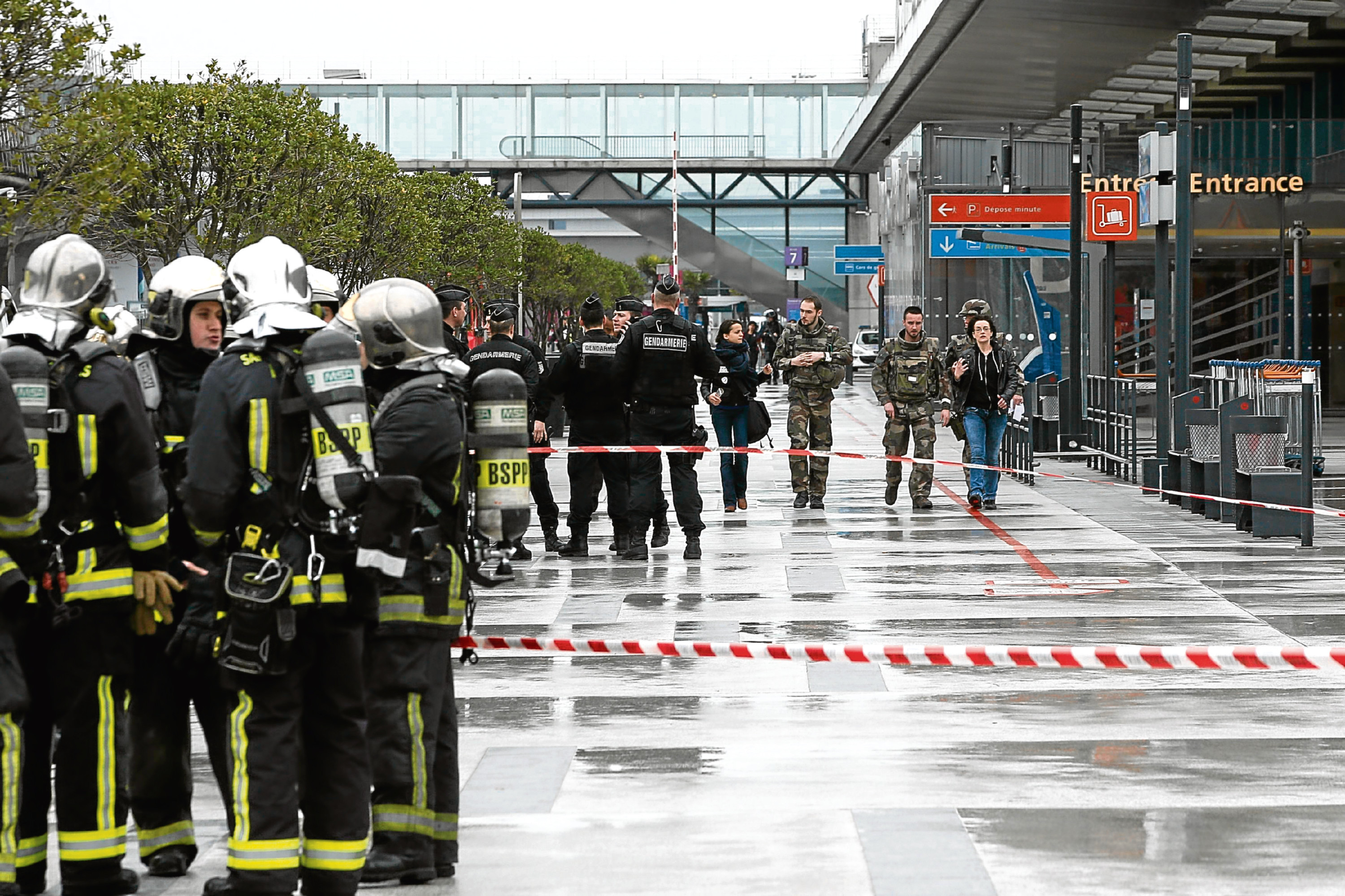 A man was shot dead after wrestling a soldier to the ground at Paris' Orly Airport and trying to take her rifle, officials said. No one else in the busy terminal was hurt, but thousands of travelers were evacuated and flights were diverted to the city's other airport. (AP Photo/Thibault Camus)