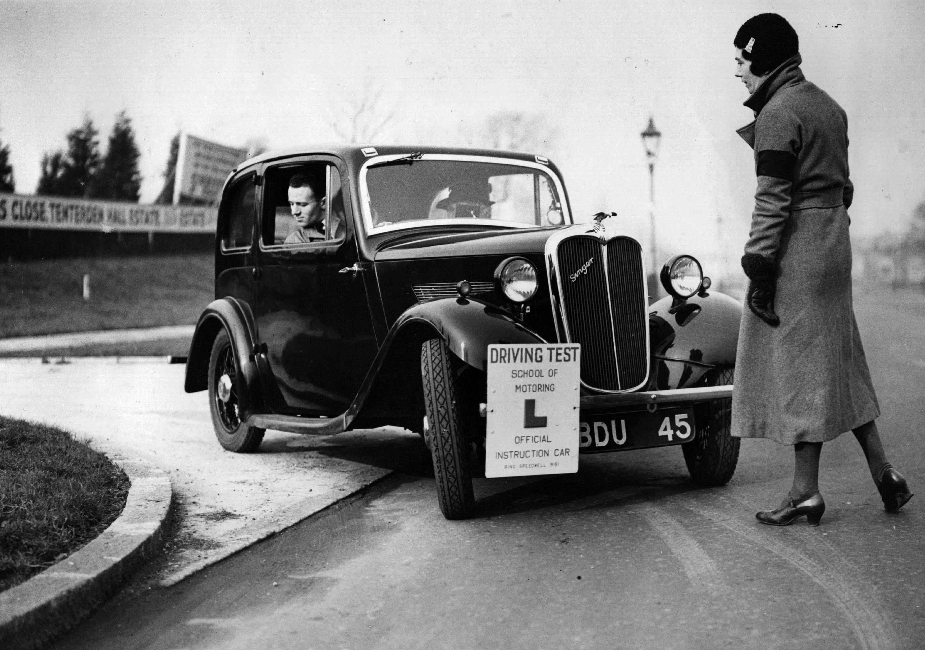 Driving instructor Miss Victoria Worsley instructs one of her pupils to reverse round a corner at her driving test school. (Fred Morley/Getty Images)