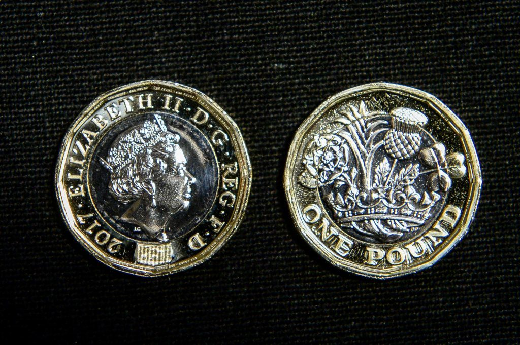 Both faces of a 12-sided one pound coin (Ben Birchall/PA Wire)
