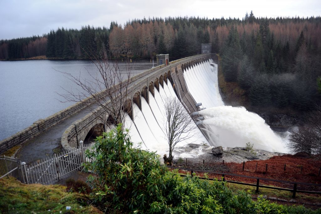 Laggan Dam releasing excess water to lower the level . Picture by Gordon Lennox 07/01/2012.