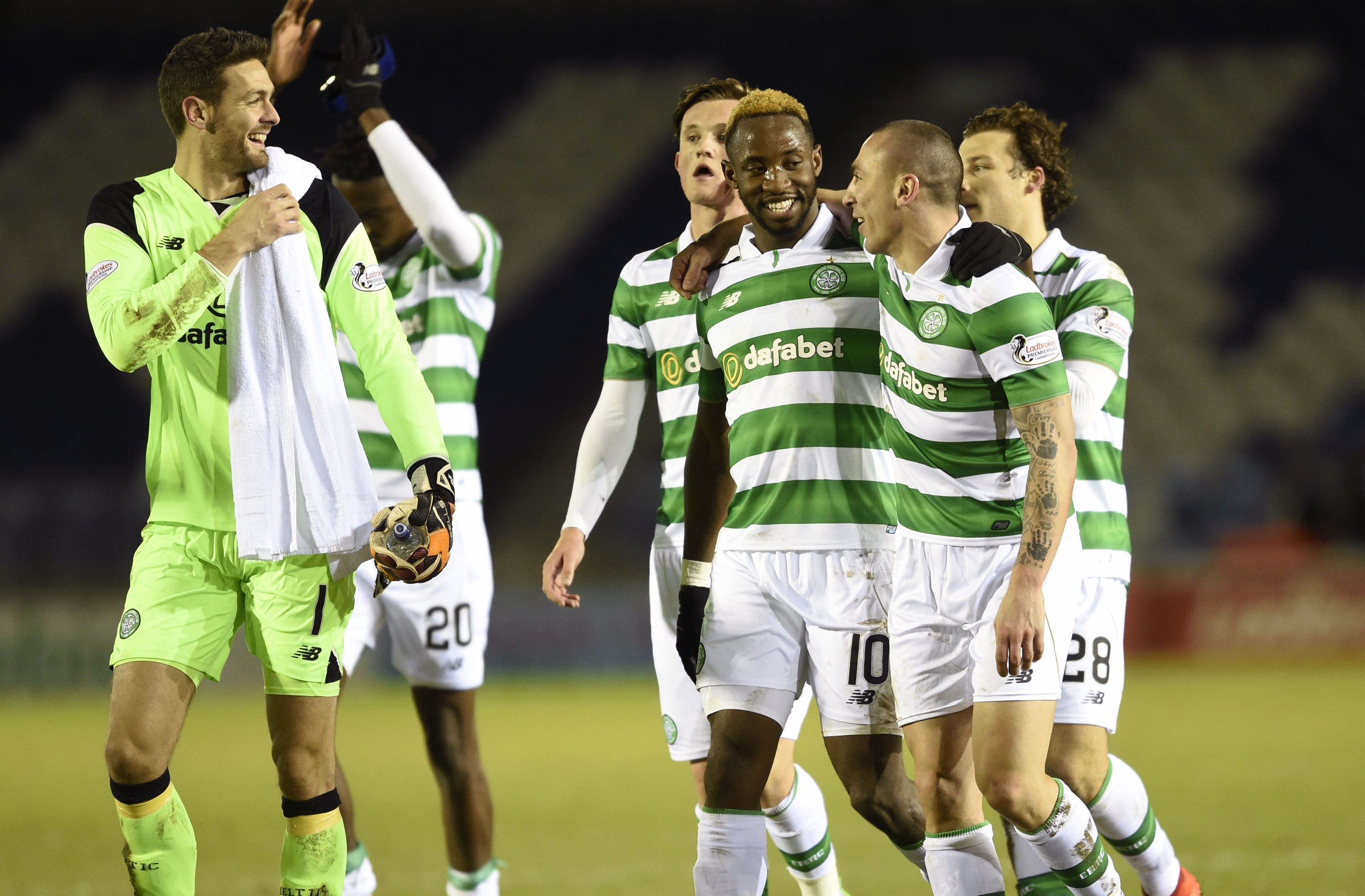 Celtic's Moussa Dembele celebrates victory with Scott Brown and goalkeeper Craig Gordon (Ian Rutherford/PA Wire)