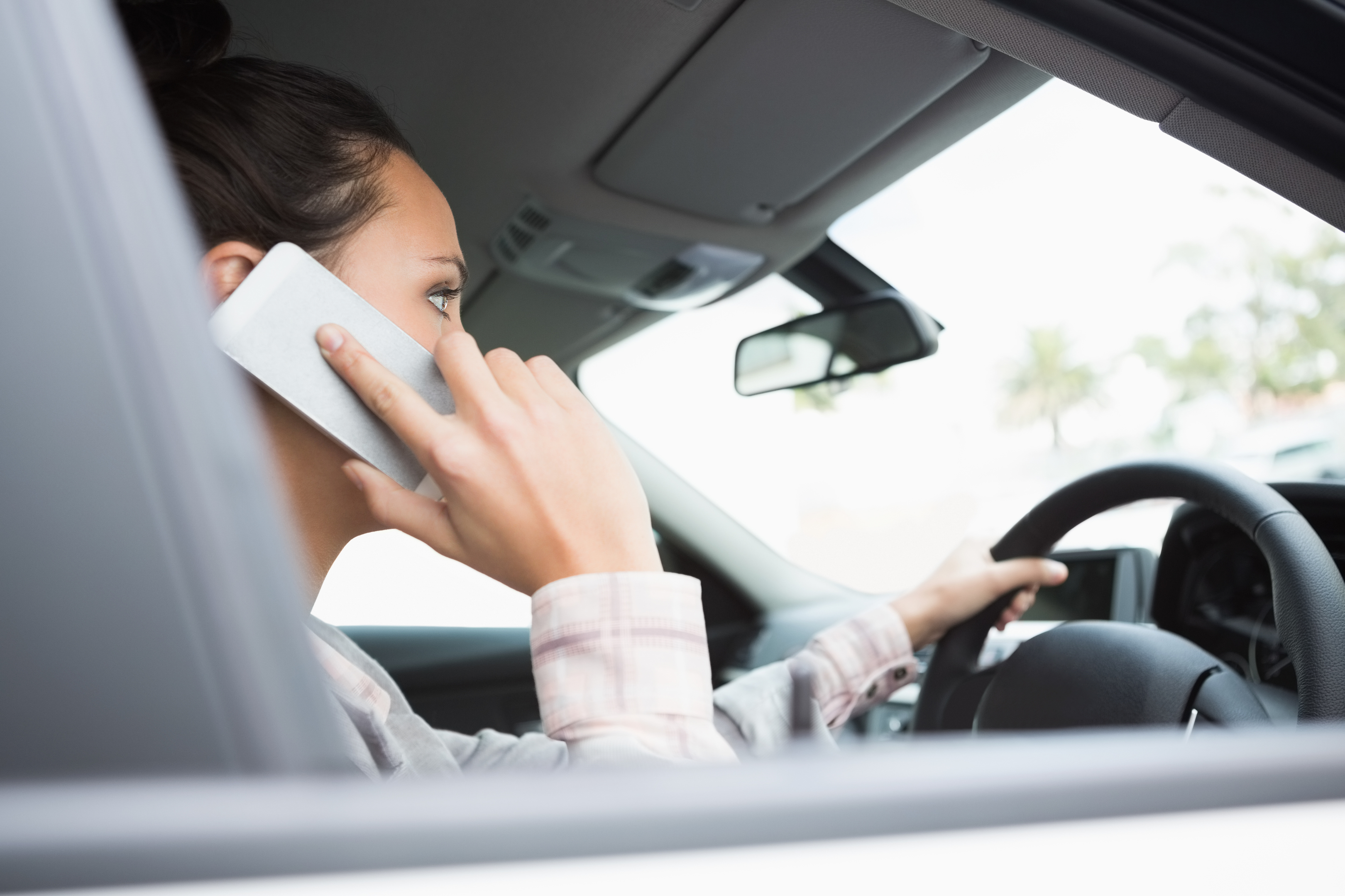 Using your phone while behind the wheel is illegal (Getty Images)