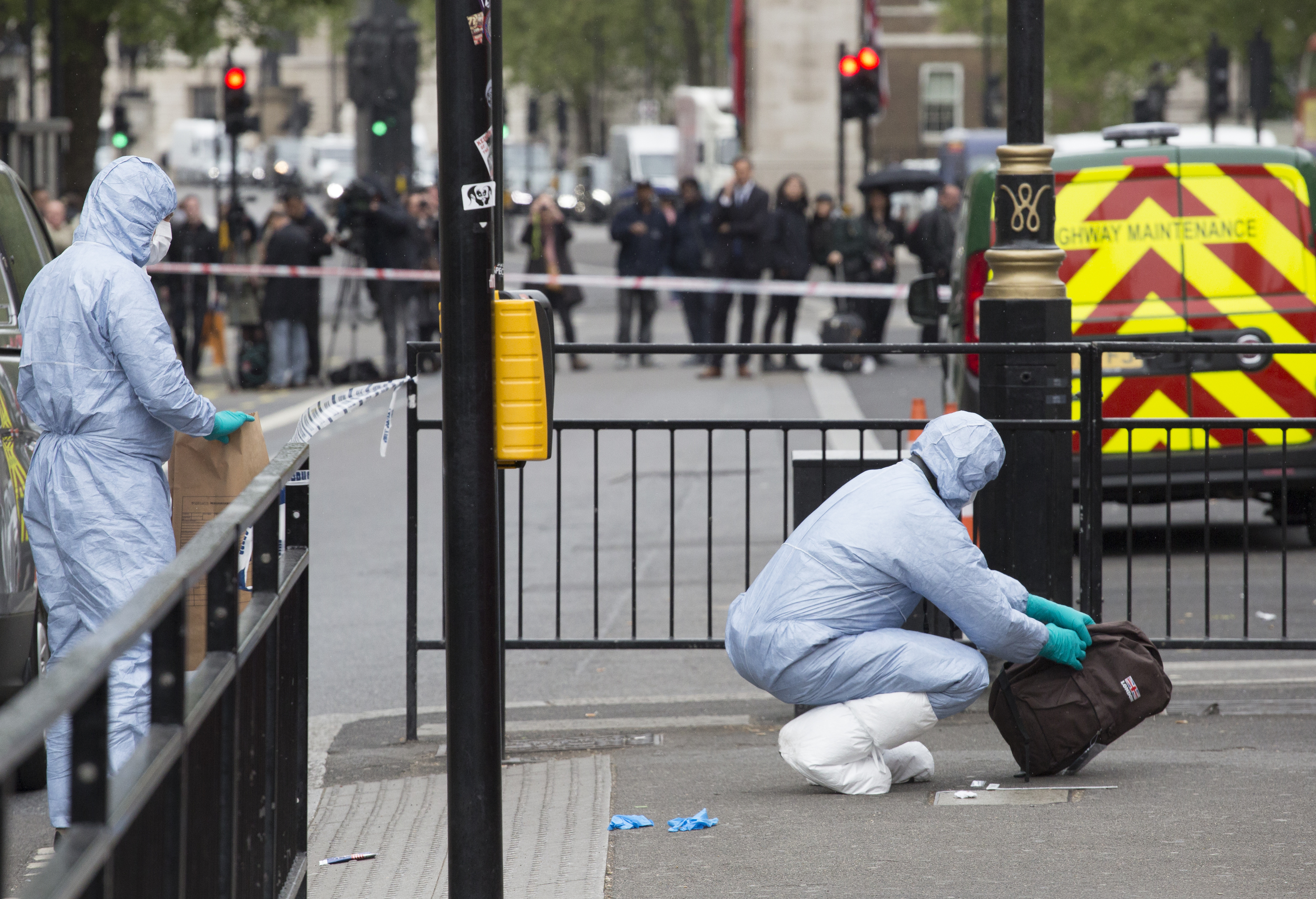 Forensic Officers collect evidence at the scene (John Phillips/Getty Images)