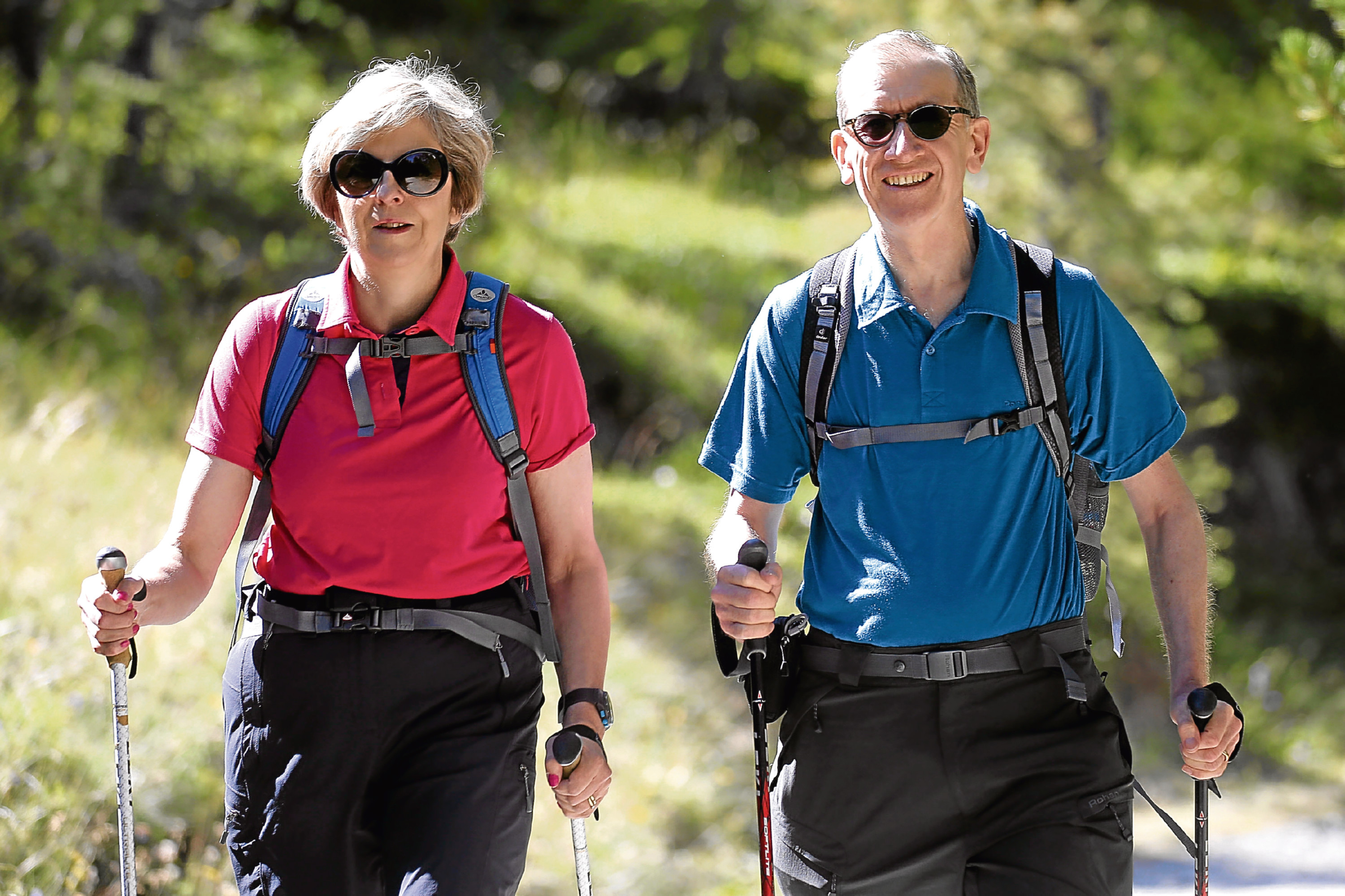 Prime Minister Theresa May walking in a forest with her husband Philip at the start of a summer holiday in the Alps (Marco Bertorello / PA Wire)