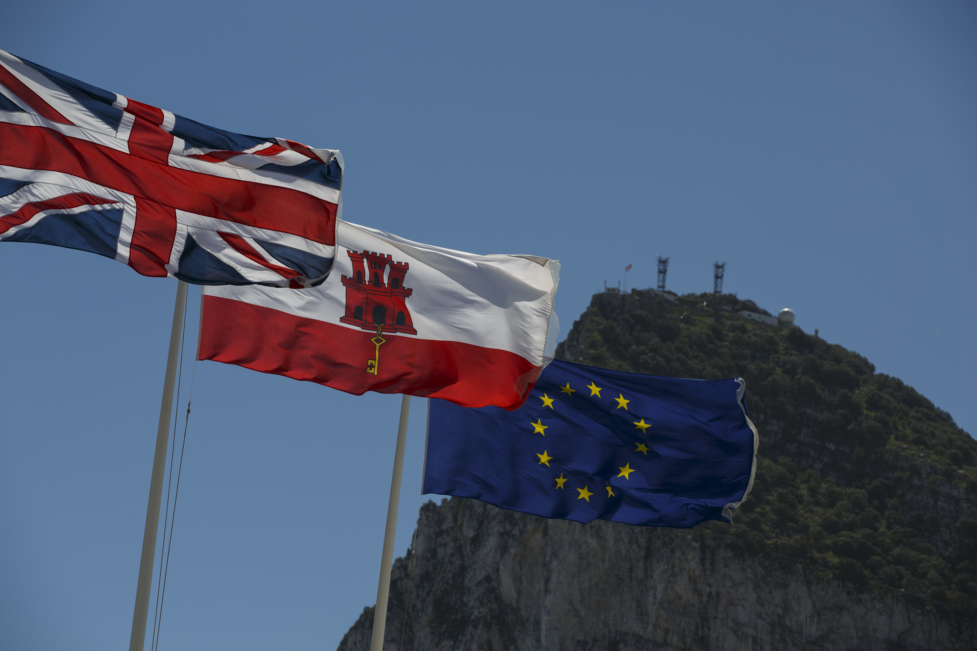 Flags of the United Kingdom, Gibraltar and the European Union are flown in front of the Rock (Pablo Blazquez Dominguez/Getty Images)