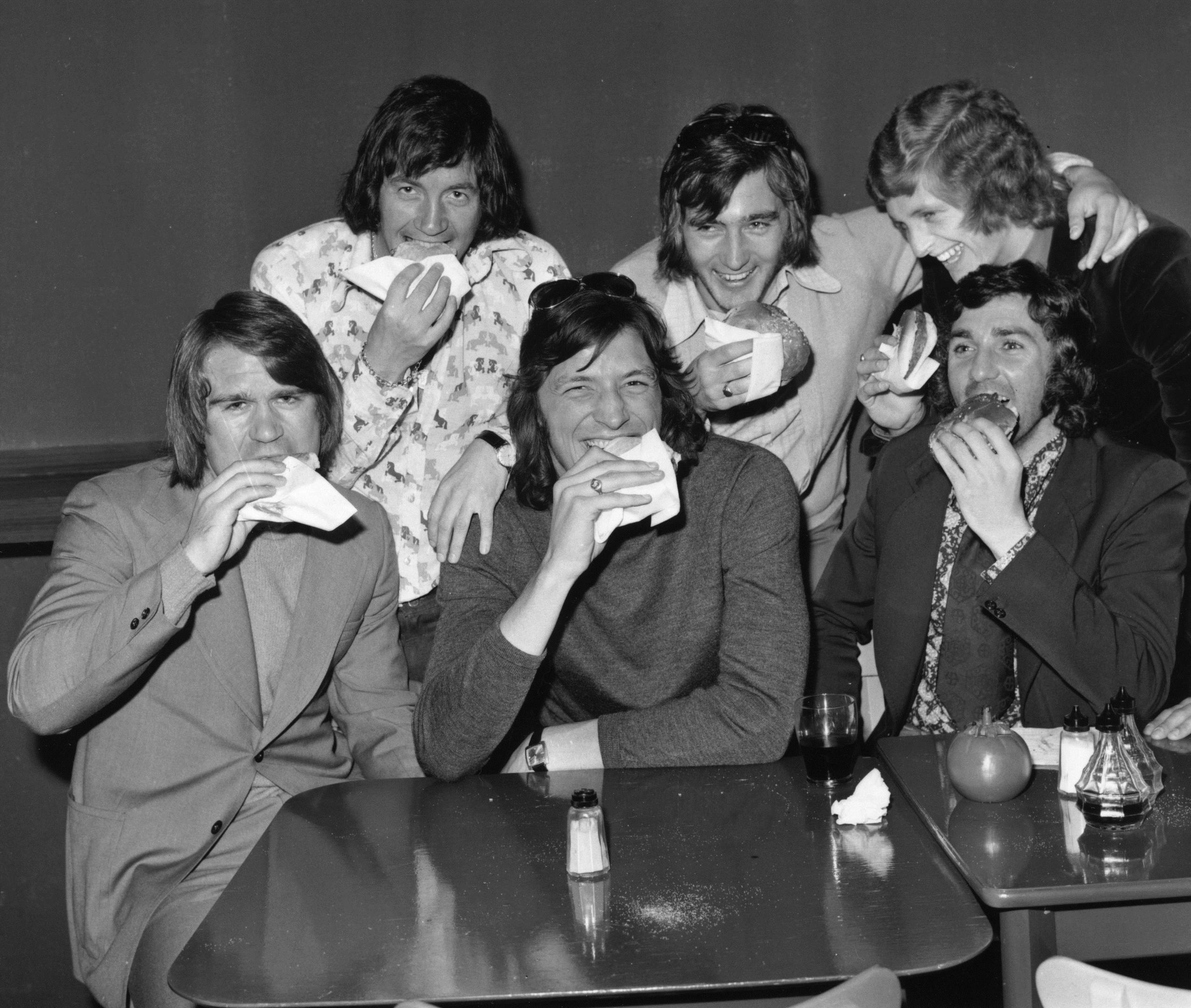 Chelsea players Dave Webb, John Boyle, Micky Droy, Alan Hudson, Chris Garland and Paddy Mulligan get stuck in to some hamburgers at a time when players weren't told to care as much about their diet (Getty Images)