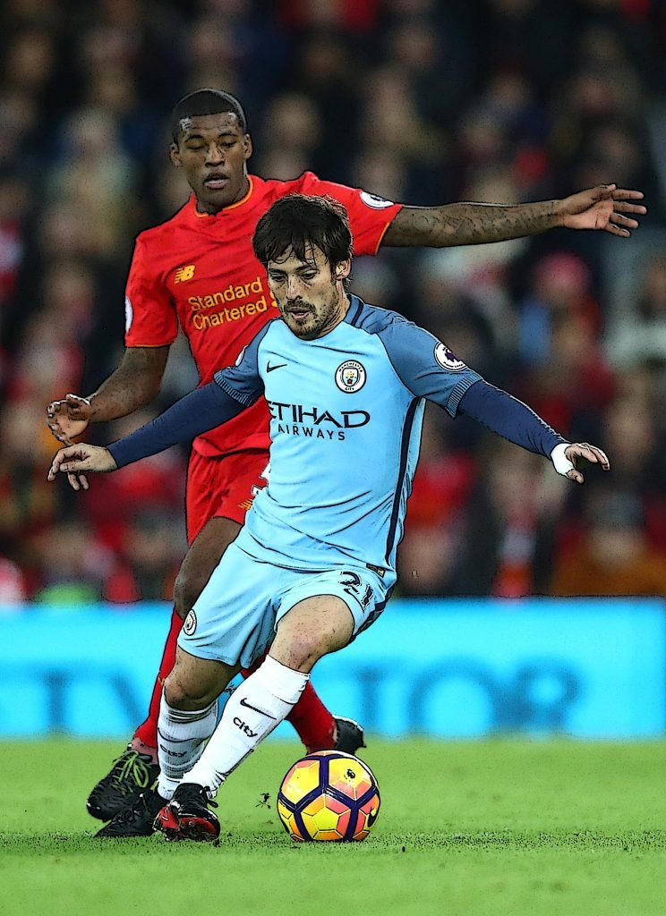 David Silva of Manchester City is chased down by Georginio Wijnaldum of Liverpool (Clive Brunskill/Getty Images)
