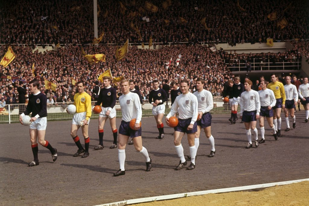 Scotland captain John Greig and England captain Bobby Moore lead out their teams ahead of the kick off (PA Wire/Press Association Images)