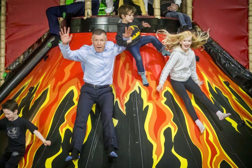 Scottish Liberal Democrat leader Willie Rennie on a slide at Jungle Adventure in Edinburgh (Danny Lawson/PA Wire)