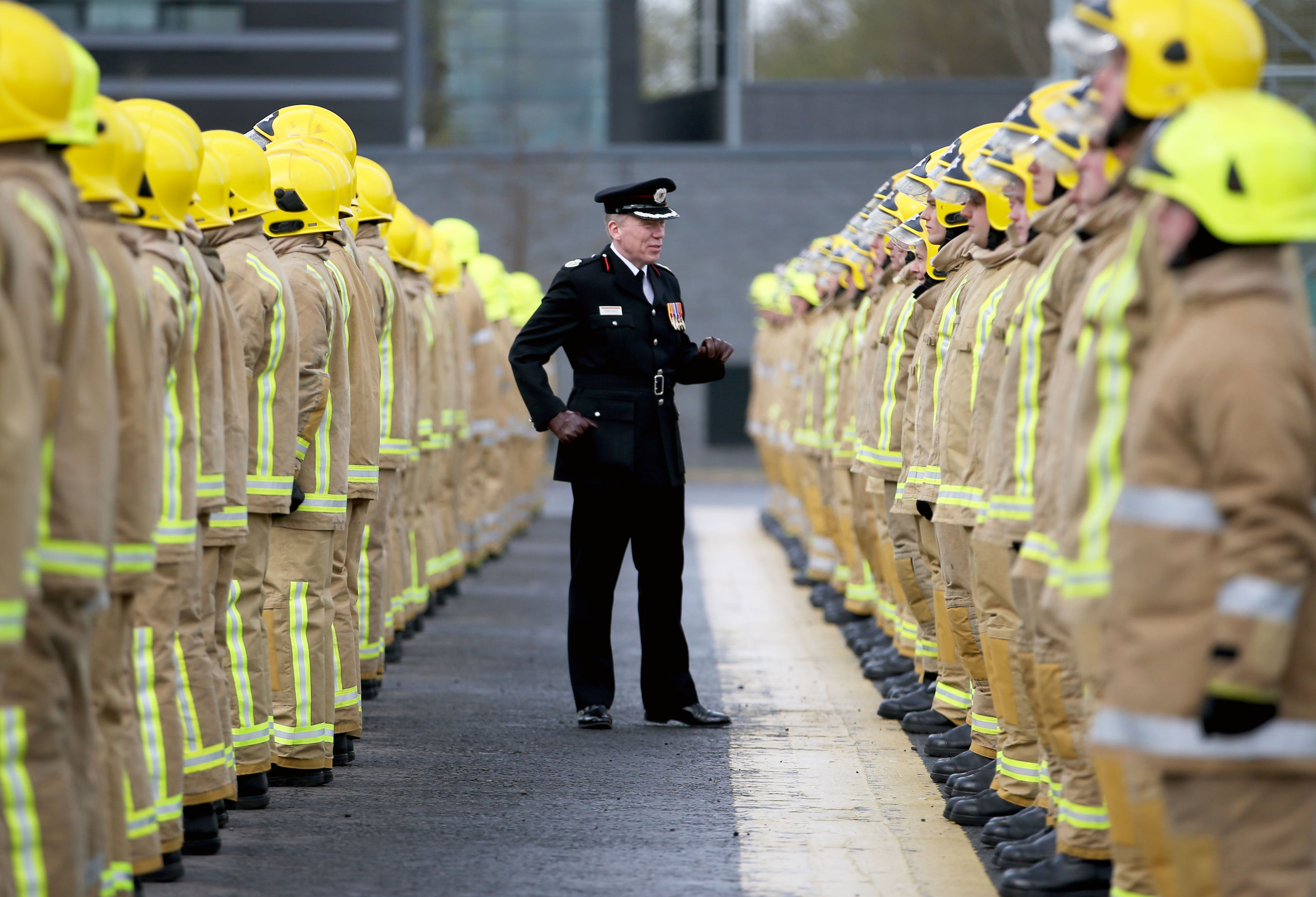 Assistant Chief Officer Lewis Ramsay inspects some of the 101 new full-time firefighters who have graduated in a special ceremony at the Scottish Fire and Rescue Service National Training Centre in Cambuslang, Glasgow. (Jane Barlow/PA Wire)