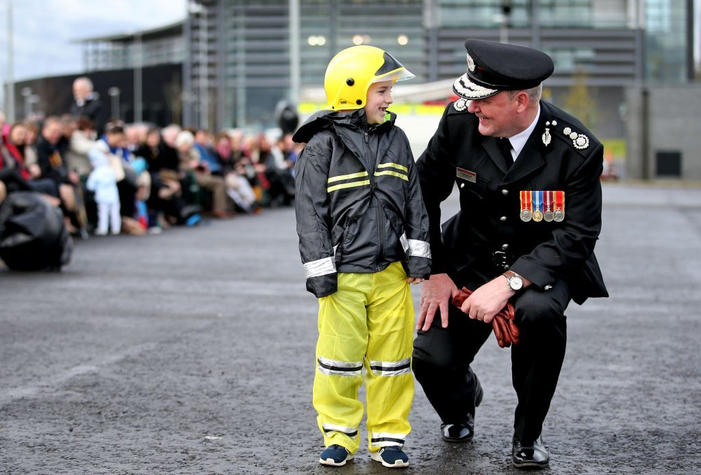 Chief Officer Alasdair Hay meets Aiden Clarke, aged 7, who watched his firefighter uncle Dominic Green graduate in a special ceremony (Jane Barlow/PA Wire)