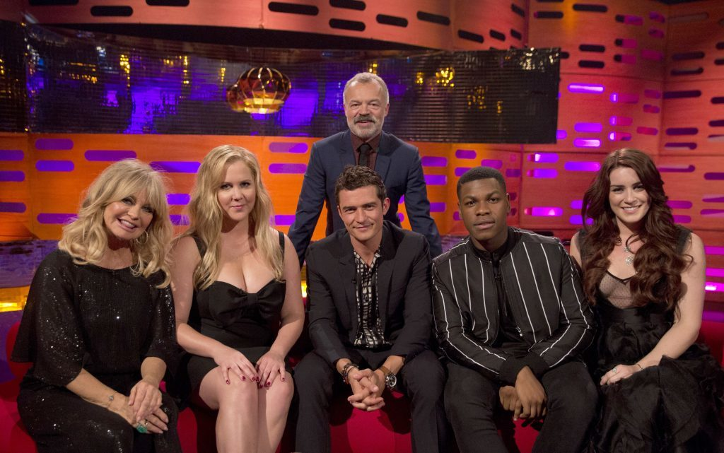 Host Graham Norton with (seated left to right) Goldie Hawn, Amy Schumer, Orlando Bloom, John Boyega and Lucie Jones during the filming of the Graham Norton Show (PA Images on behalf of So TV)