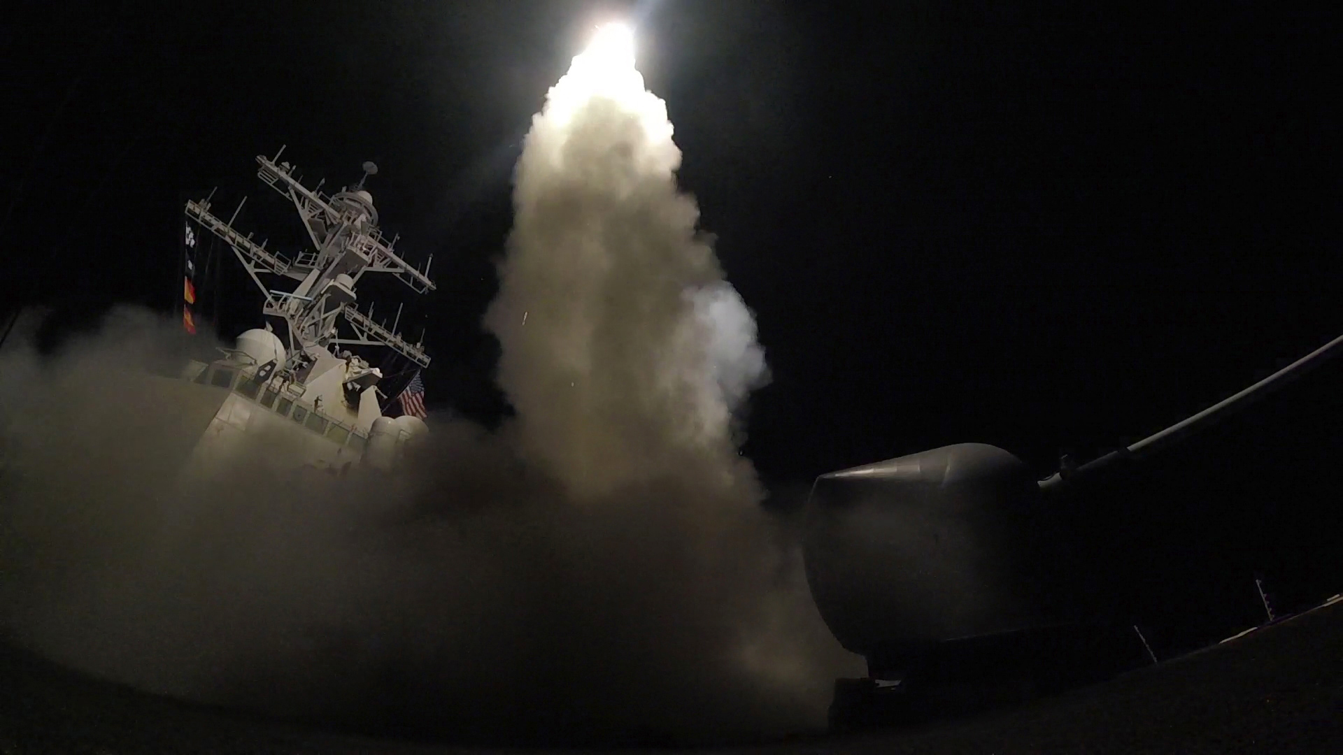 The United States blasted a Syrian air base with a barrage of cruise missiles in fiery retaliation for this week's gruesome chemical weapons attack against civilians. (Mass Communication Specialist 3rd Class Ford Williams/U.S. Navy via AP)