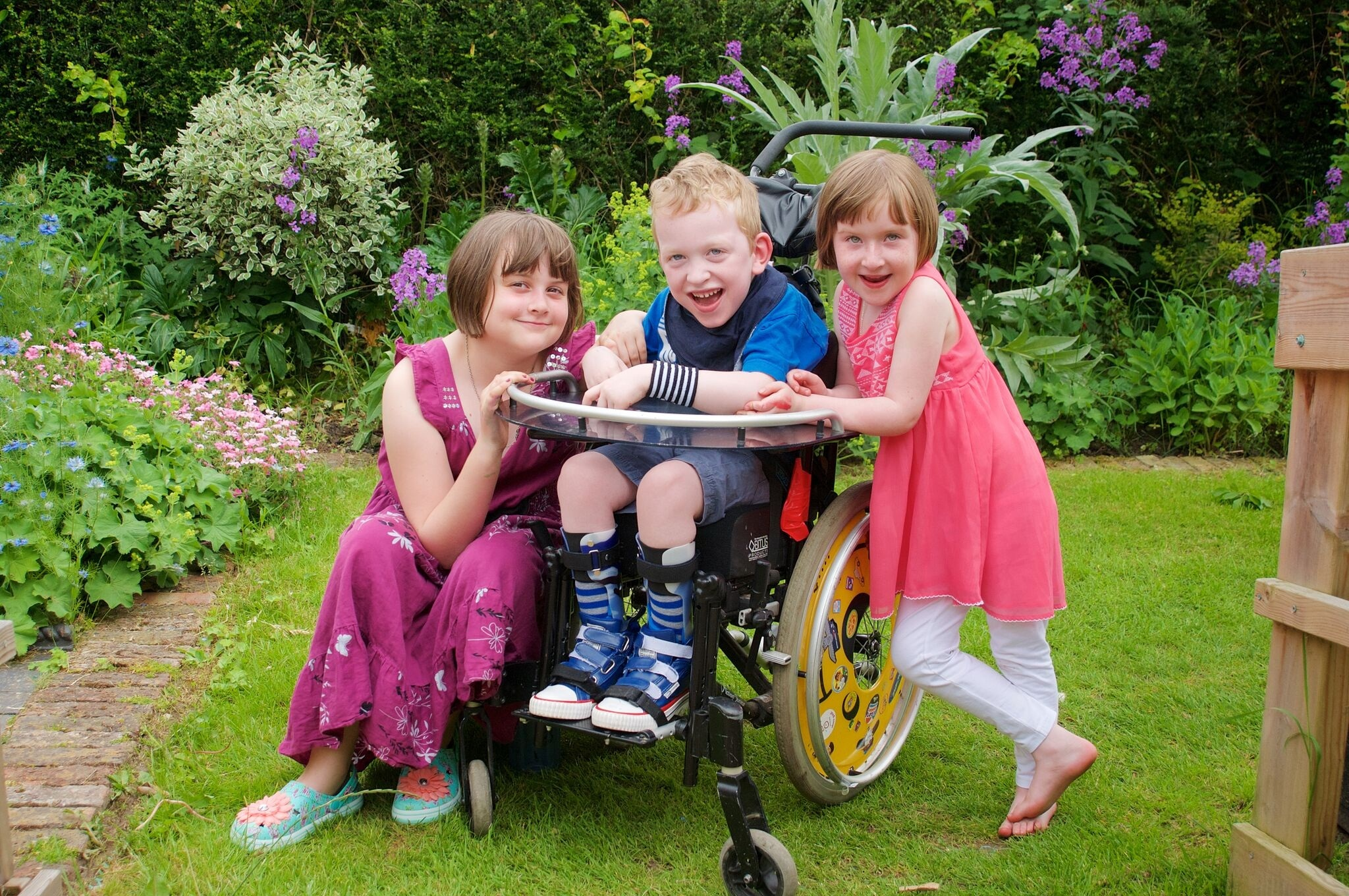 Tom with big sister Molly (left), who's eight, and twin sister Iris.