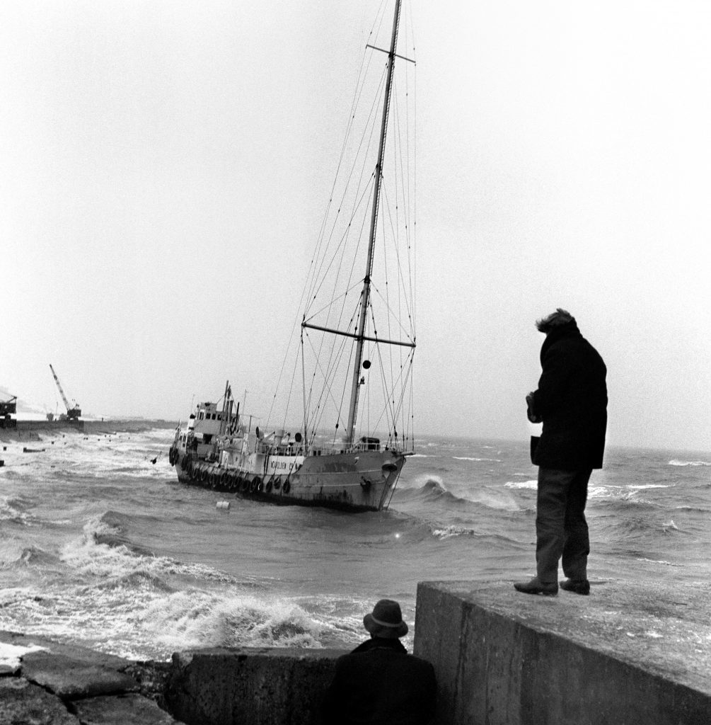 "The ""pirate"" radio ship Radio Caroline aground in rough water, 1966 (PA Archive)"