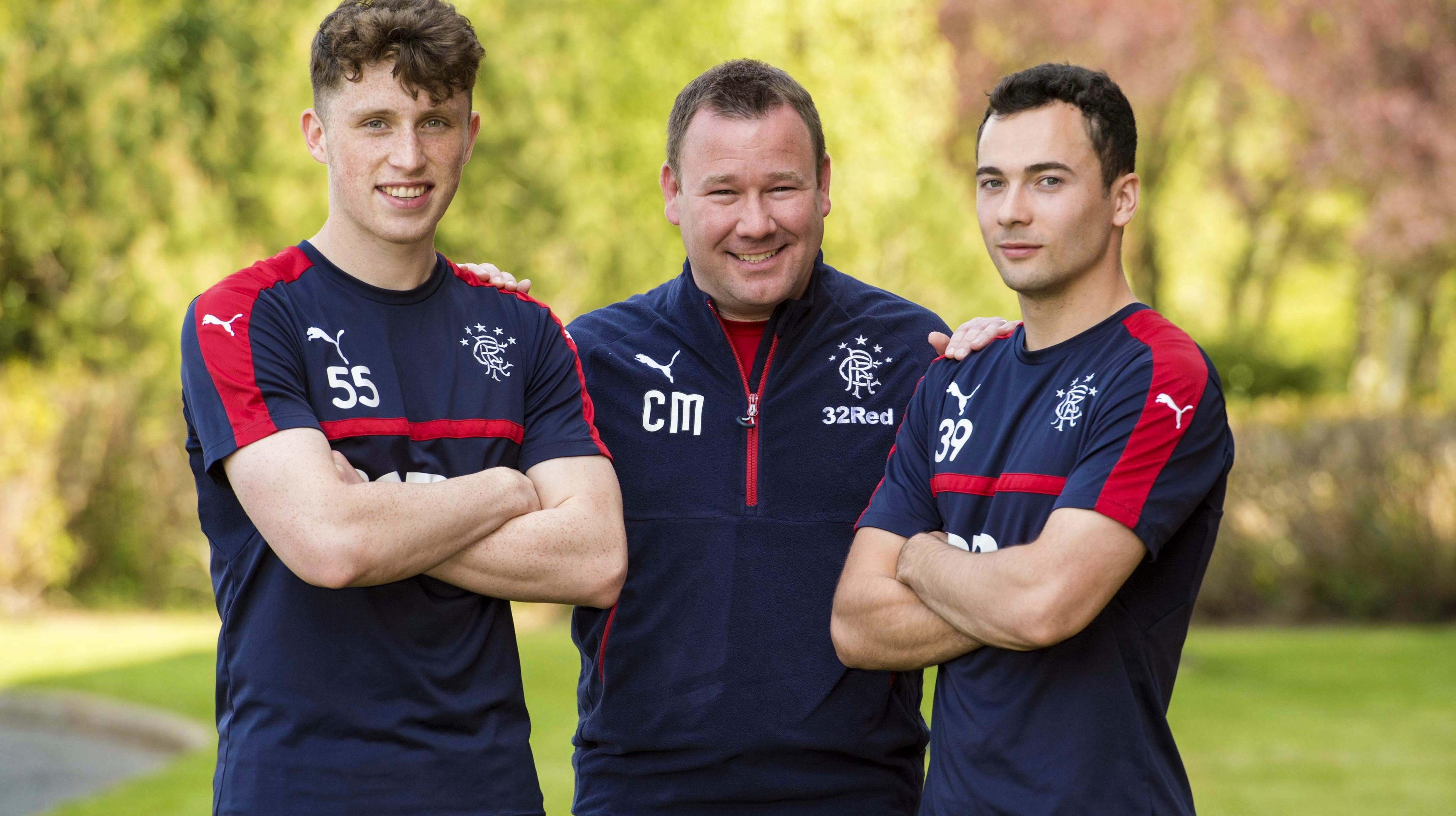 Rangers' Head of Academy Craig Mulholland (centre) with youth players Jamie Barjonas (L) and Ross Lyon (SNS Group)