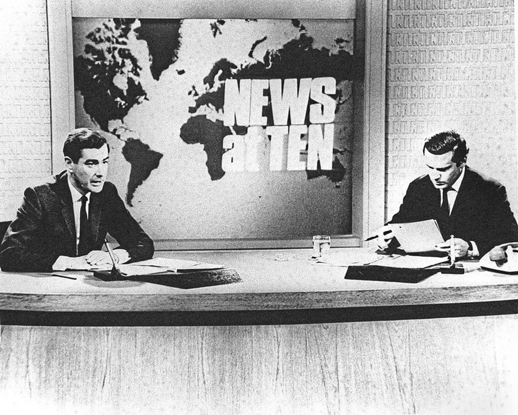 Alastair Burnet and Reginald Bosanquet in the early days of News At Ten (PA)