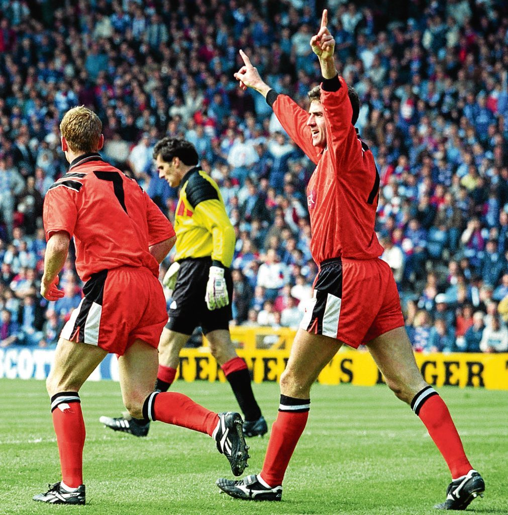 Brewster celebrates after netting the only goal of the match (SNS Group)