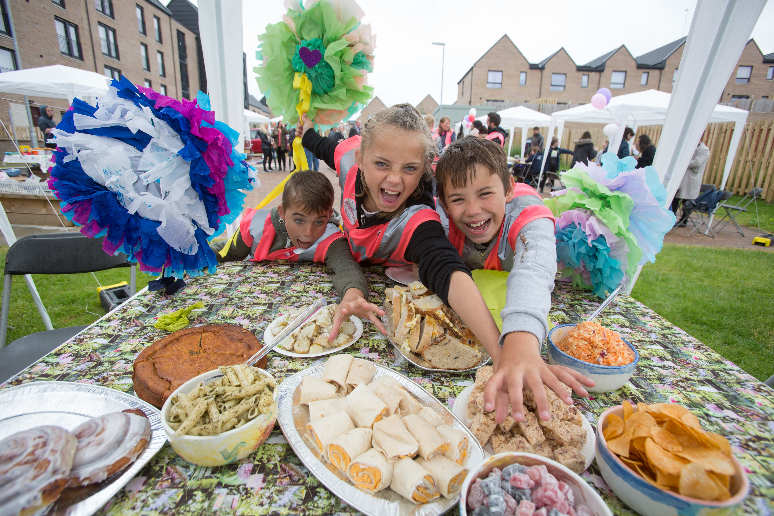 Local youngsters Robert Wilson 12 , Courtney Wilson 10 and John Wilkie 10 help themselves to food at the eighth annual Big Lunch, a project by the Eden Project and supported by Big Lottery Fund which took place last year. (Martin Shields)