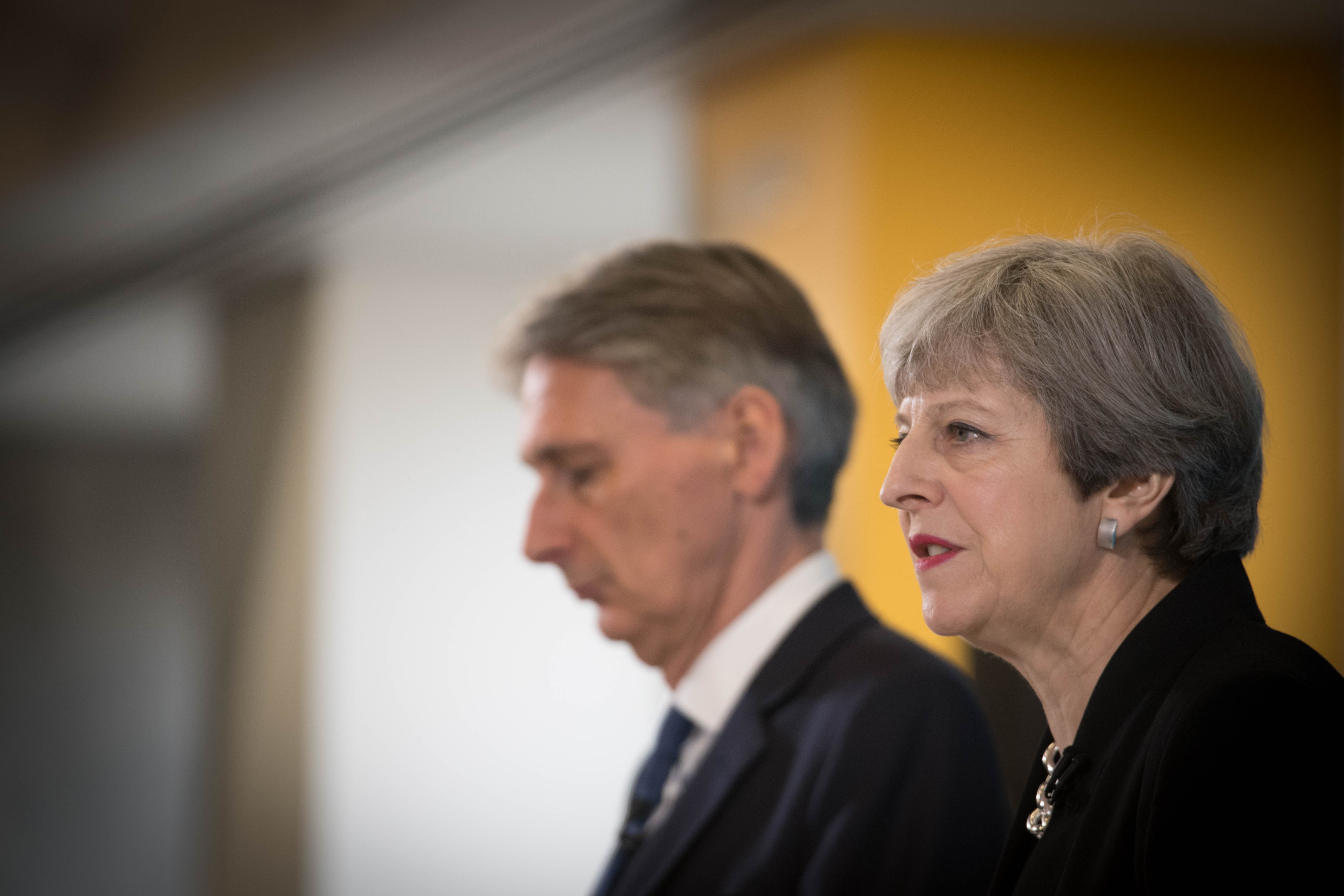 Conservative party leader Theresa May and Chancellor Philip Hammond during a general election campaign (Stefan Rousseau/PA Wire)