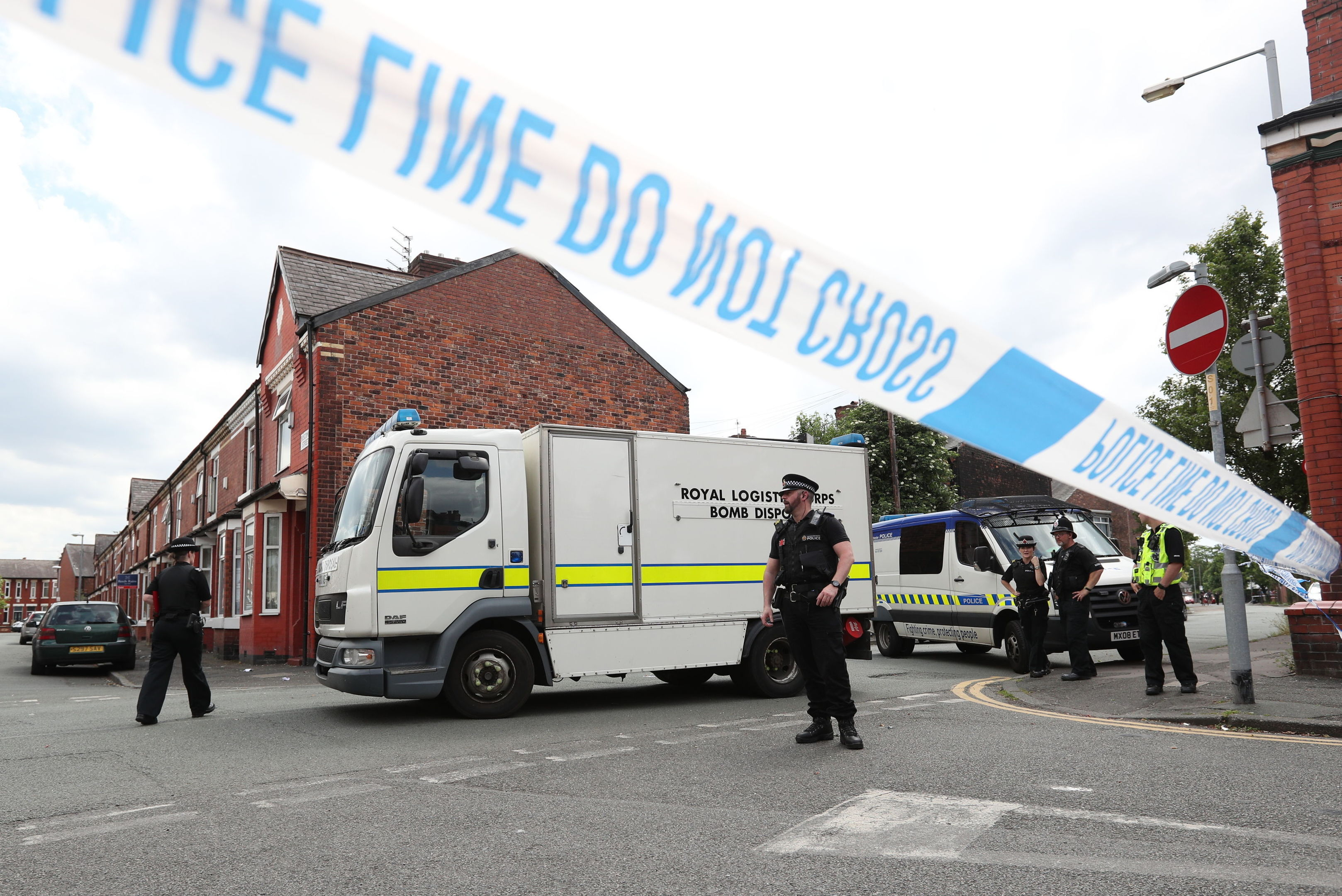 Police and a bomb disposal unit at the junction between Boscombe Street and Yew Tree Road in the Moss Side area of Manchester, after an evacuation took place as part of an ongoing search following the terror attack in the city earlier this week. (Jonathan Brady/PA Wire)