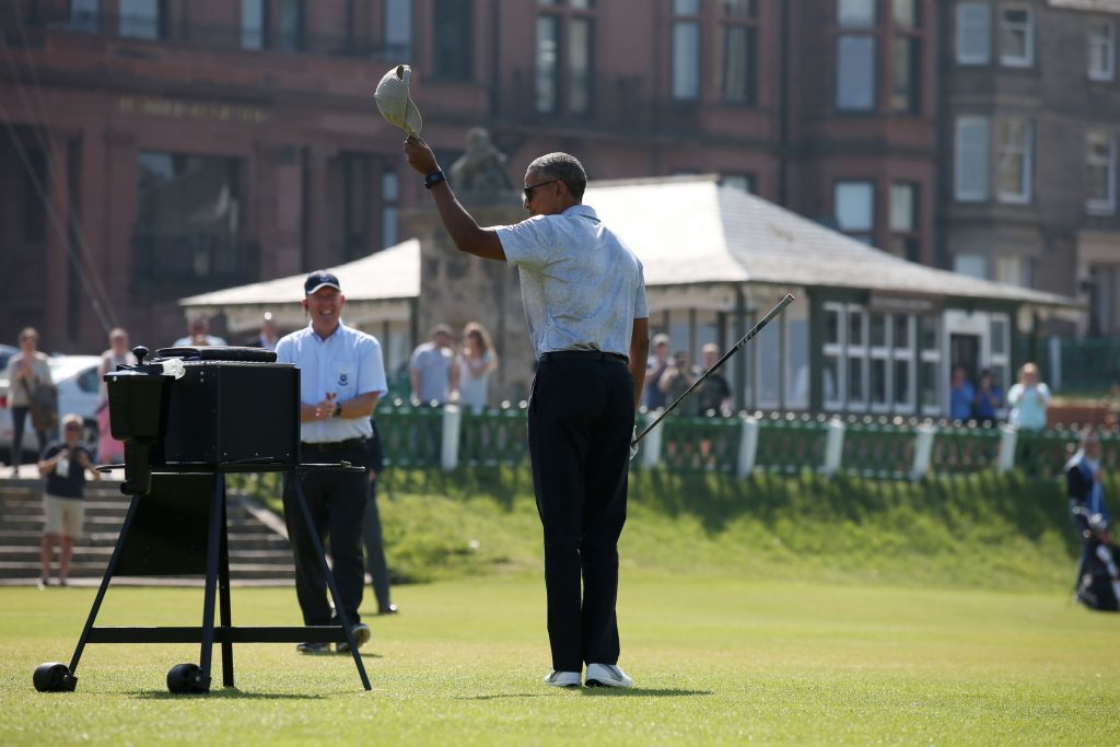 Obama salutes the gathering crowd (Andrew Milligan/PA Wire)
