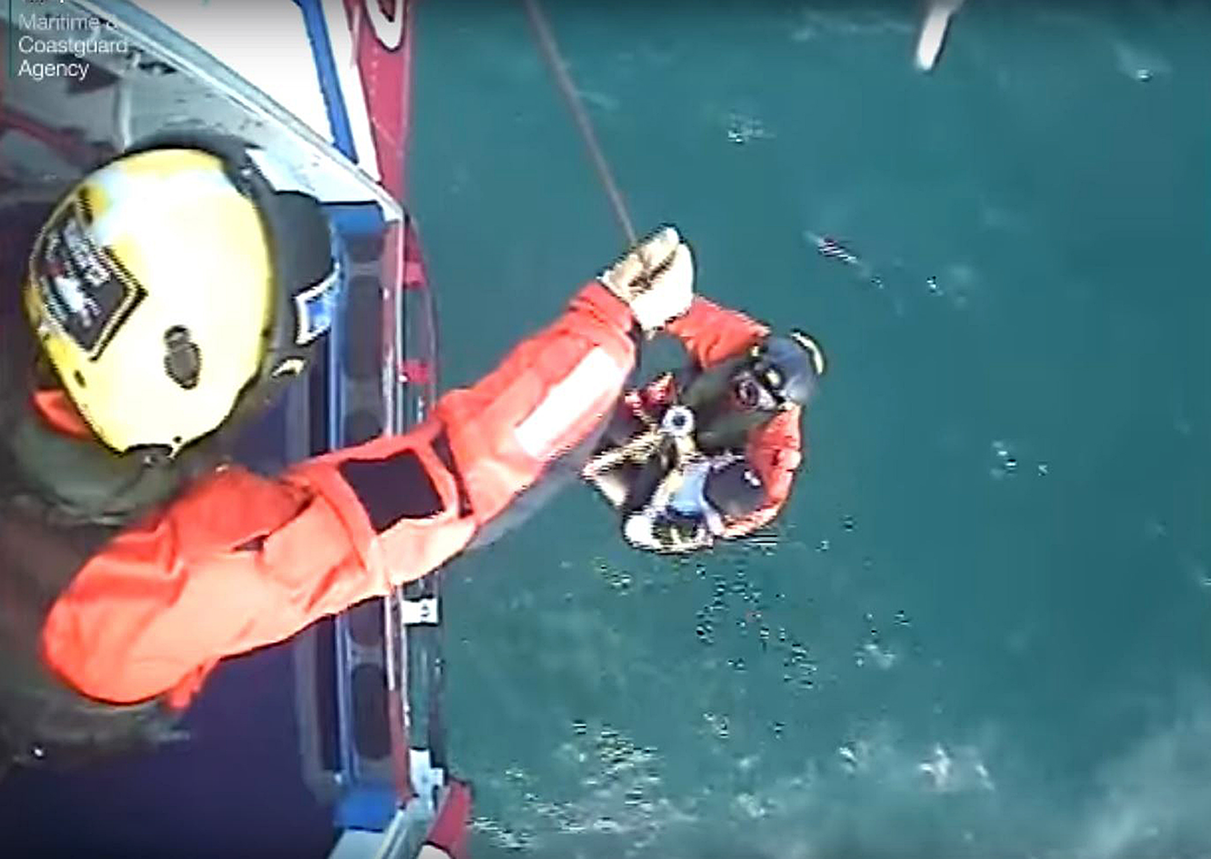 The moment surfer Matthew Bryce, who survived more than 30 hours stranded at sea on his board, was rescued. (Maritime &Coastguard Agency/PA Wire)