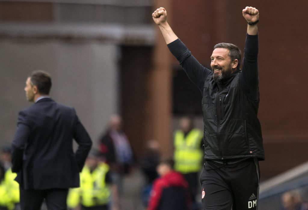 Aberdeen manager Derek McInnes celebrates after his side take the lead (SNS Group / Craig Williamson)