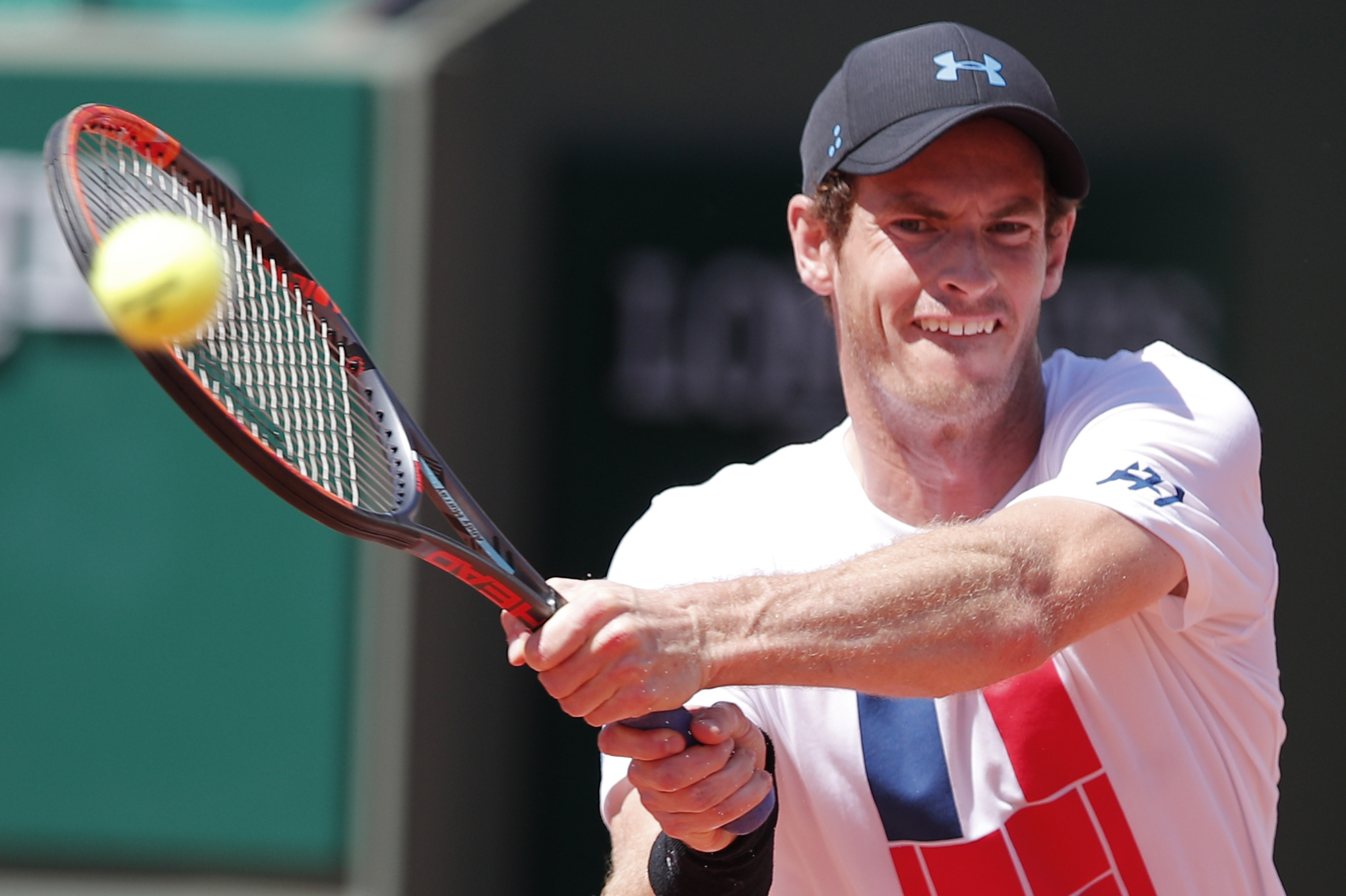 Britain's Andy Murray returns the ball during a training session for the French Open tennis tournament, at the Roland Garros stadium (AP Photo/Christophe Ena)