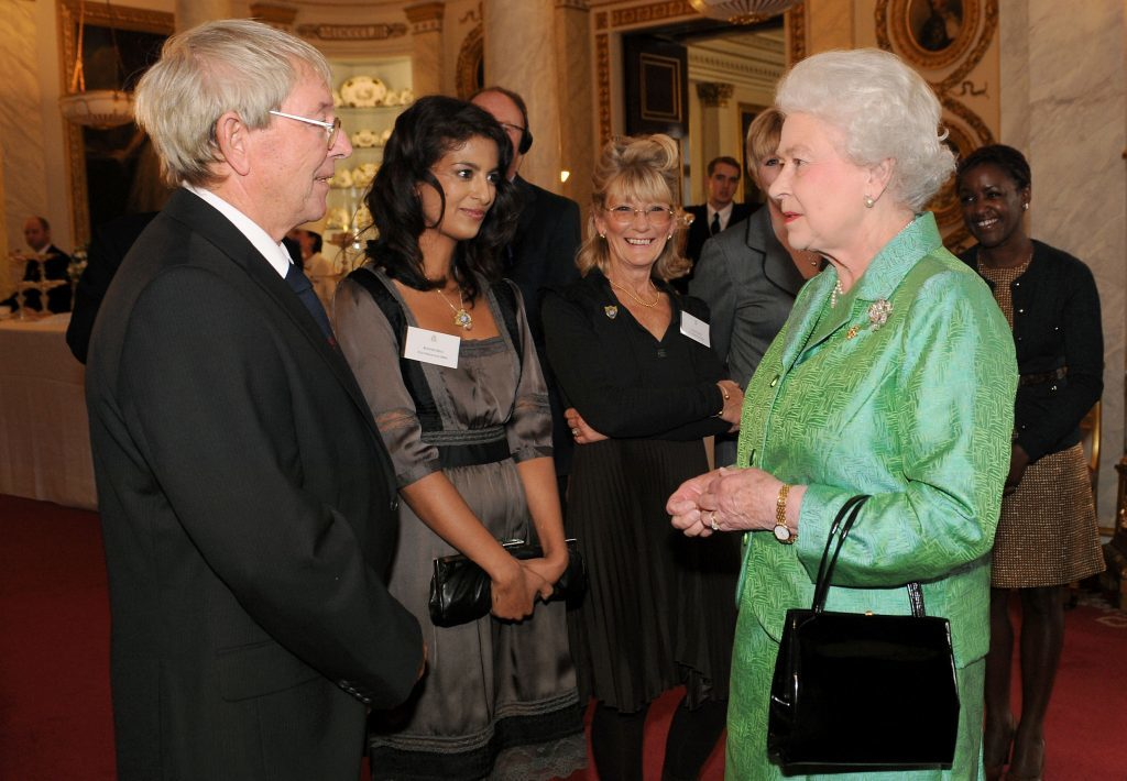 The Queen with Blue Peter presenter John Noakes during a reception to mark the programme's 50th birthday (Fiona Hanson/PA)