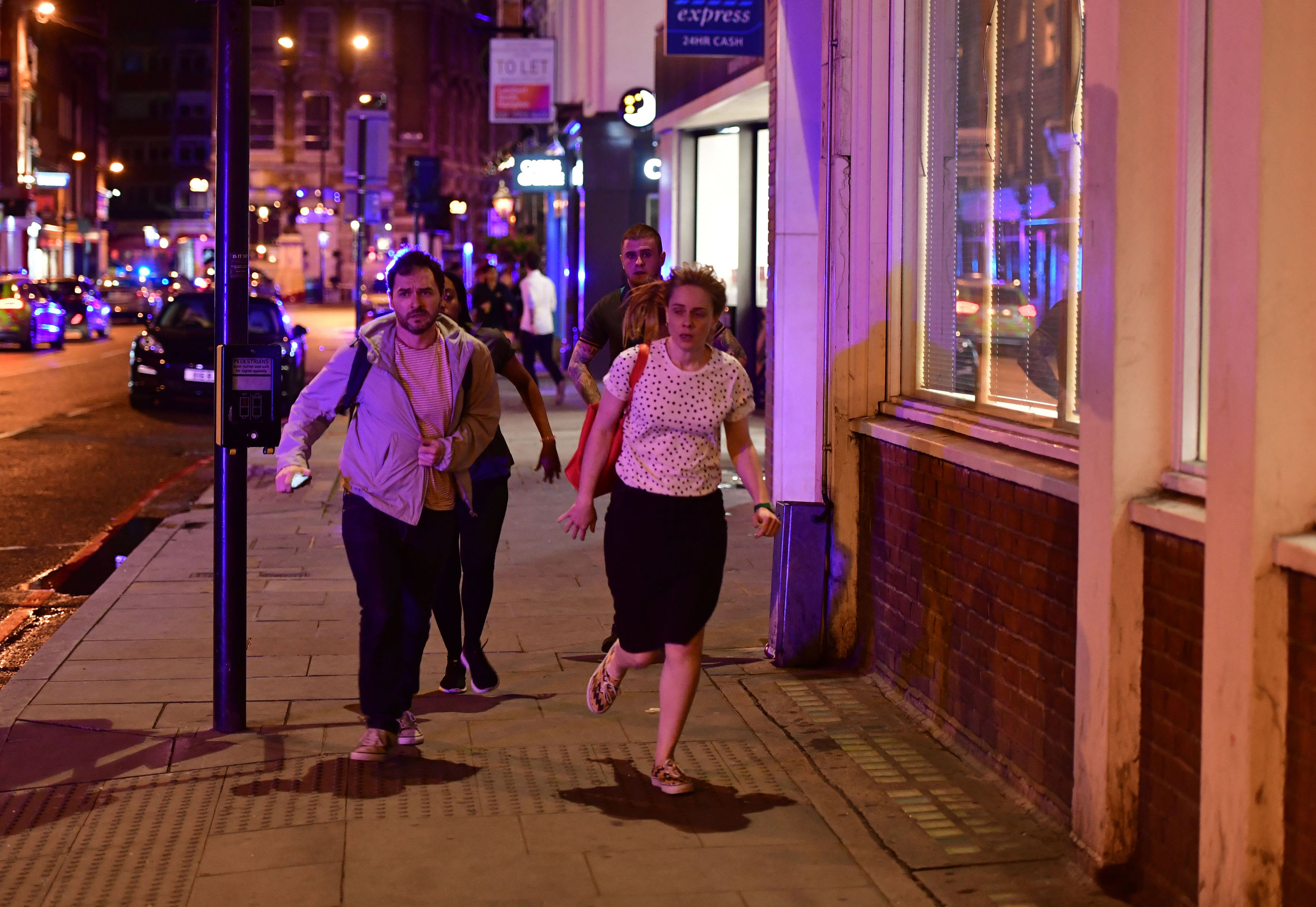 "People run down Borough High Street as police are dealing with a ""major incident"" at London Bridge. (Dominic Lipinski/PA Wire)"
