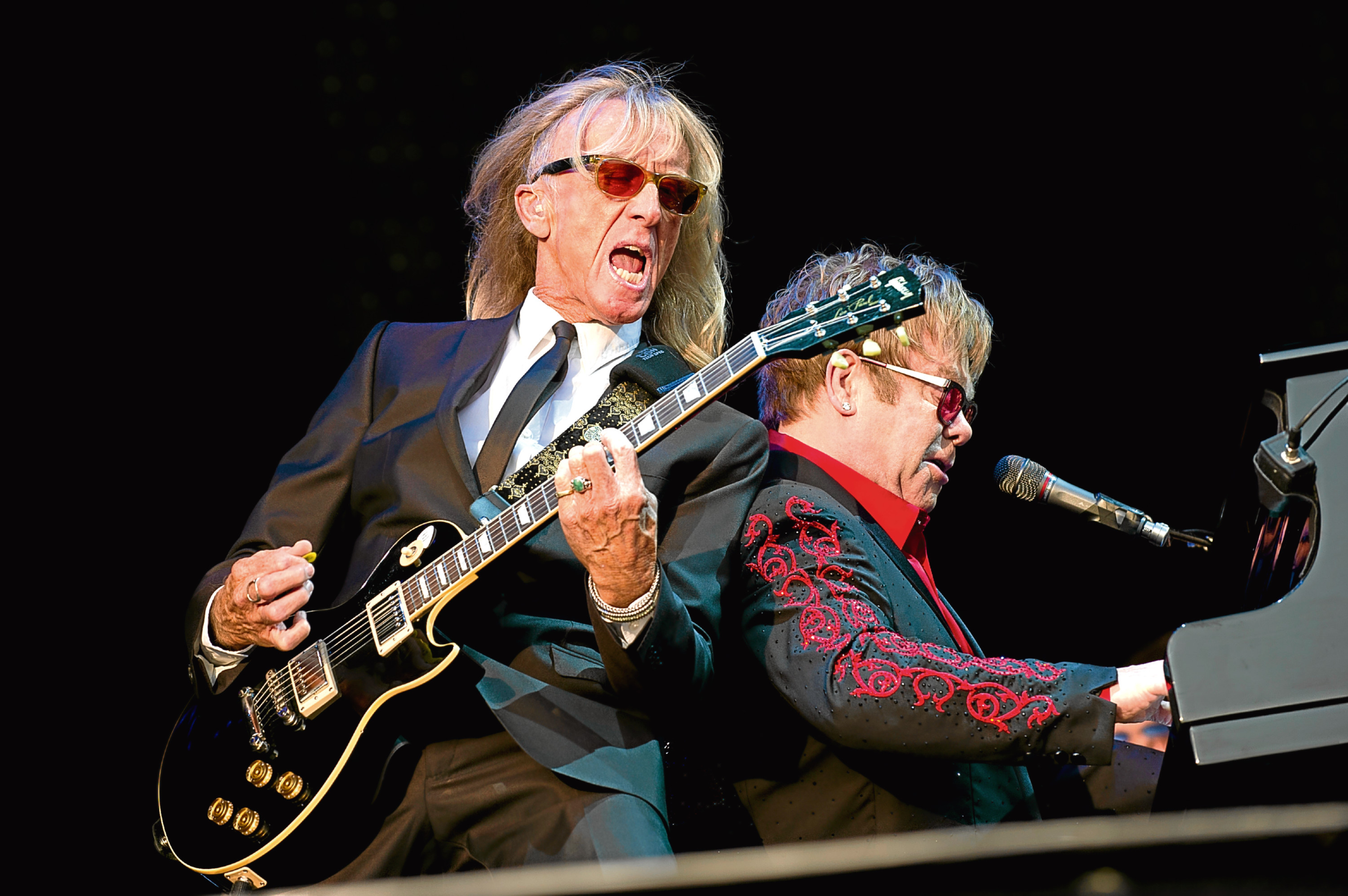 Scottish guitarist Davey Johnstone (L) performing with Elton John (Emily Wabitsch / DPA/PA Images)