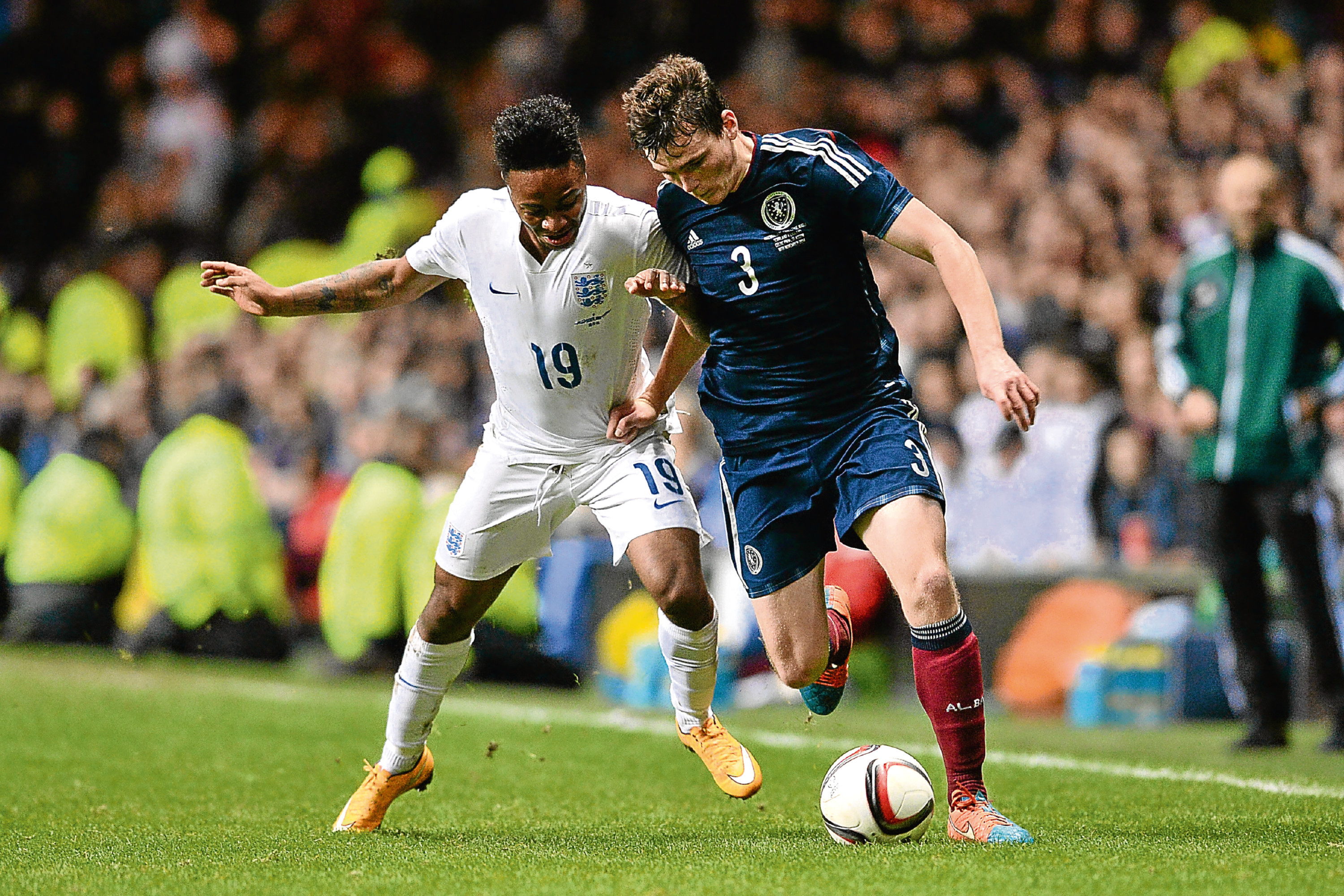 Scotland's Andrew Robertson (right) in action against England (SNS Group)