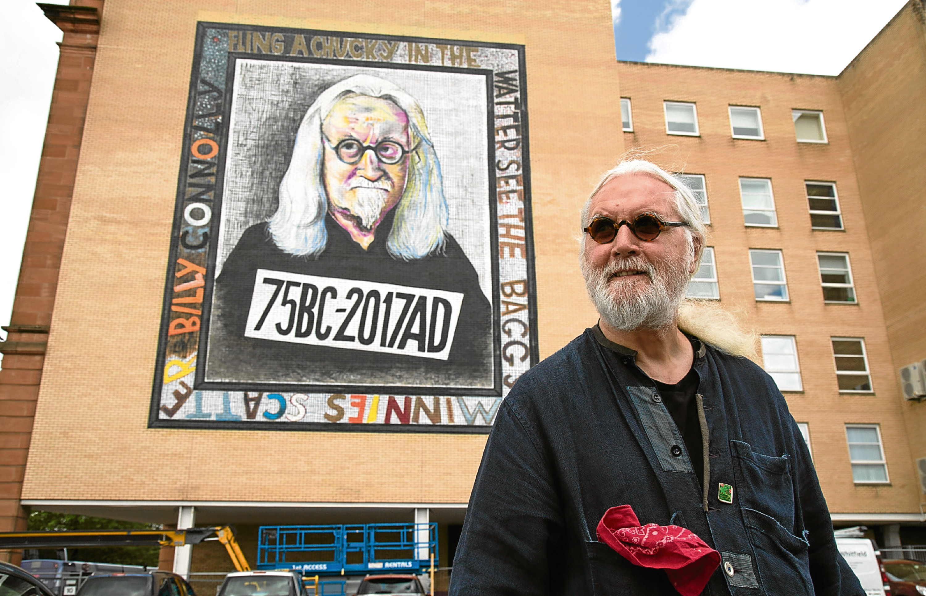 Billy Connolly tours the giant murals of him in Glasgow (BBC)