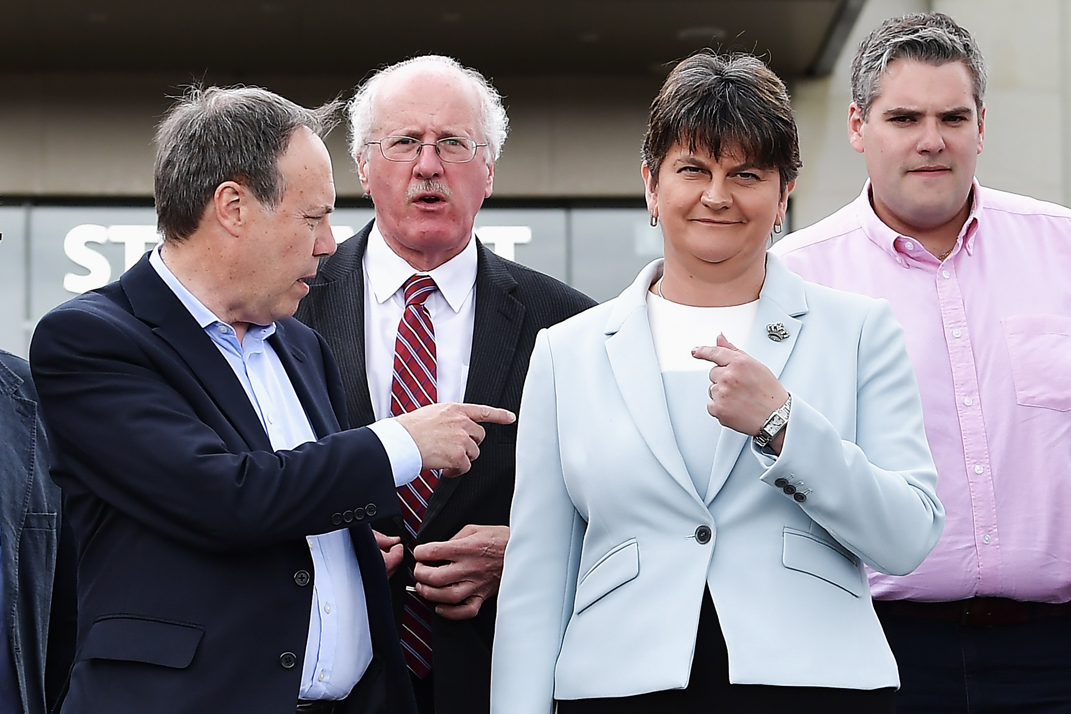 DUP Leader Arlene Foster (R) stands with DUP Deputy Leader Nigel Dodds (L) and fellow DUP MP's after addressing the news of a possible Parliamentary agreement with the Conservative party following yesterday's election on June 9, 2017 in Belfast, Northern Ireland. (Charles McQuillan/Getty Images)