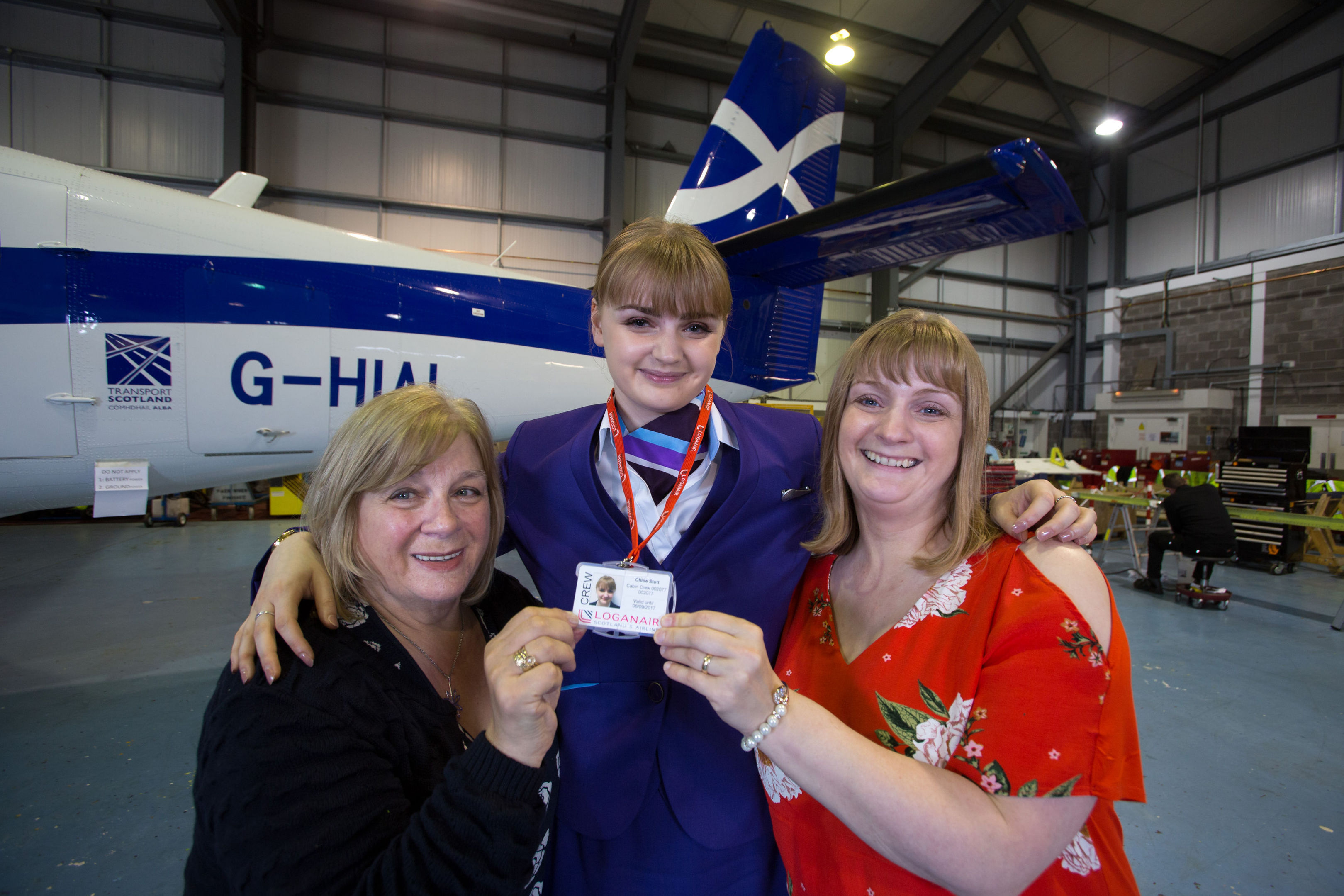 Newly qualified Loganair Cabin Crew Chloe Stott (centre) with her mum Katy Stott (right) and grandmother Freida Devin (Martin Shields/Loganair/PA Wire)