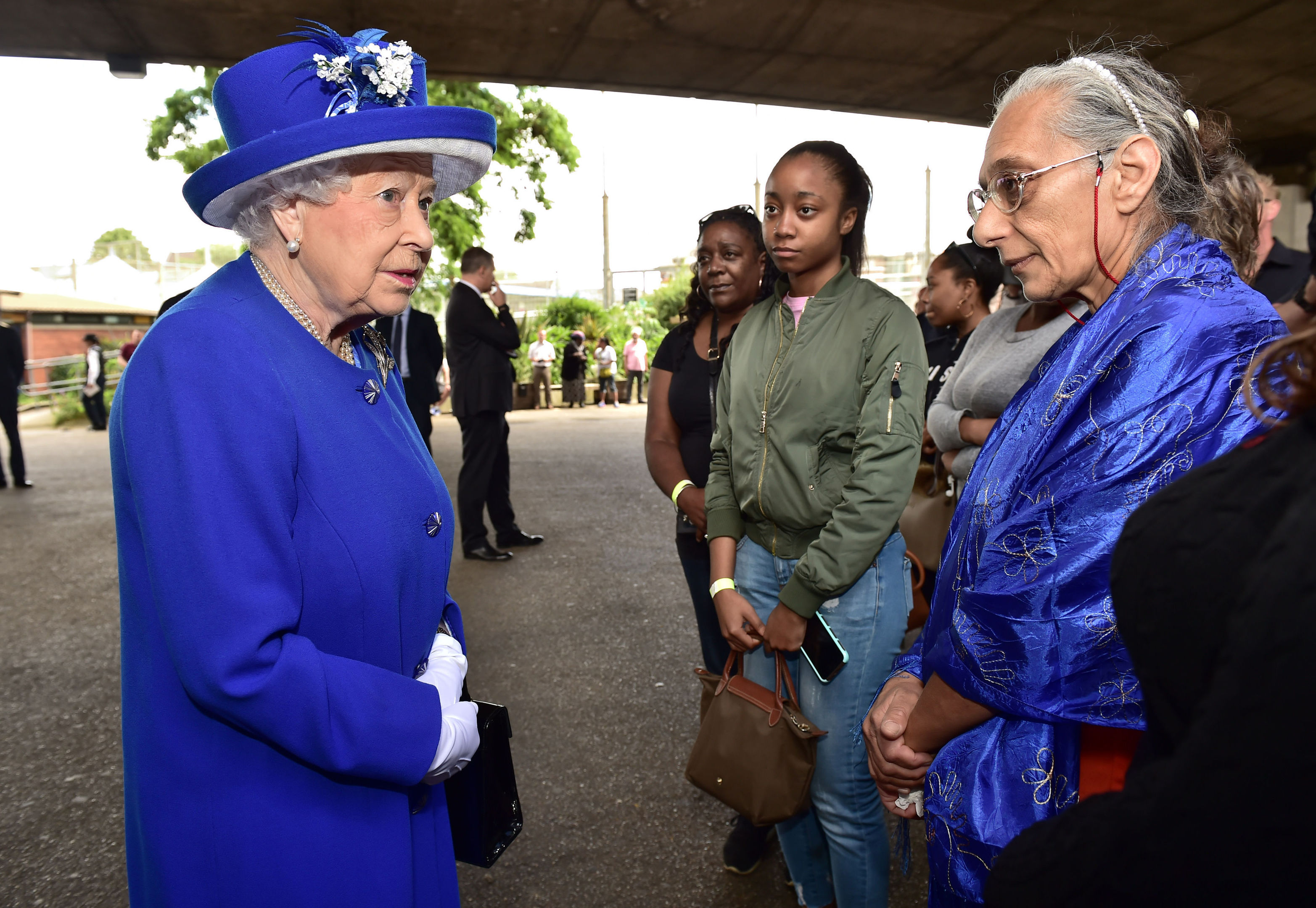 Queen Elizabeth II meets members of the community affected by the fire at Grenfell Tower (Dominic Lipinski/PA Wire)